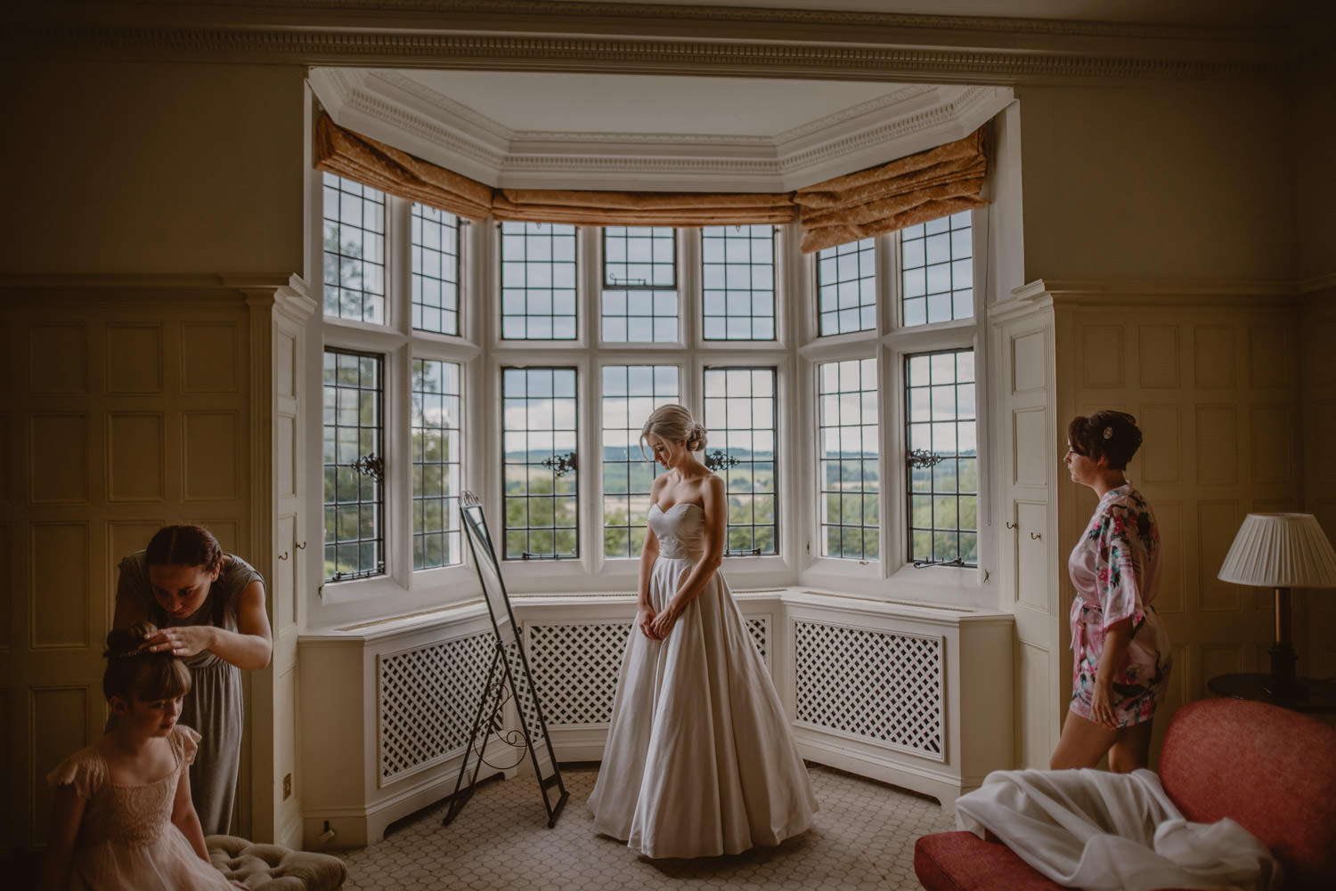 Bride getting ready at Danesfield House Hotel just before the ceremony