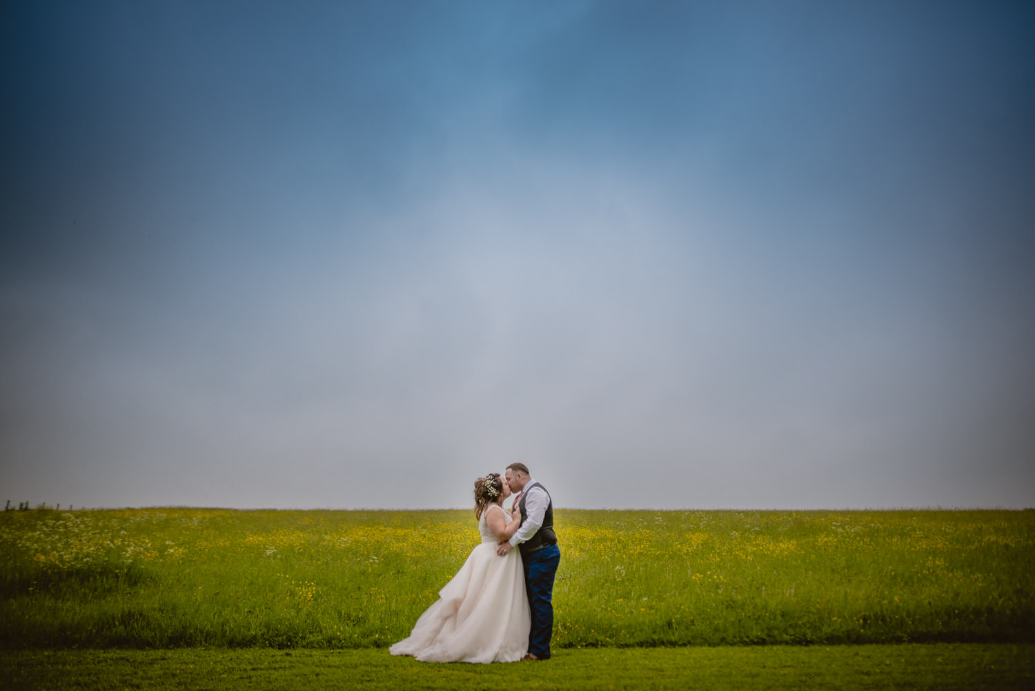 Portrait and creative photo of a married couple kissing at Cripps Barn during their wedding day