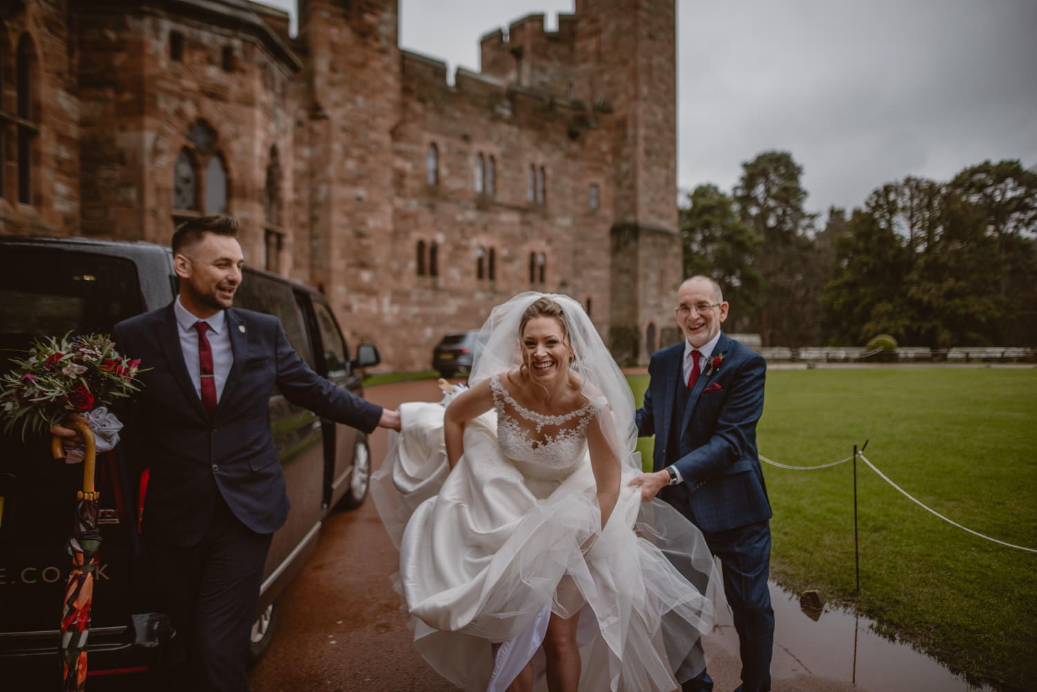 Bride rushing to her wedding at Peckforton Castle