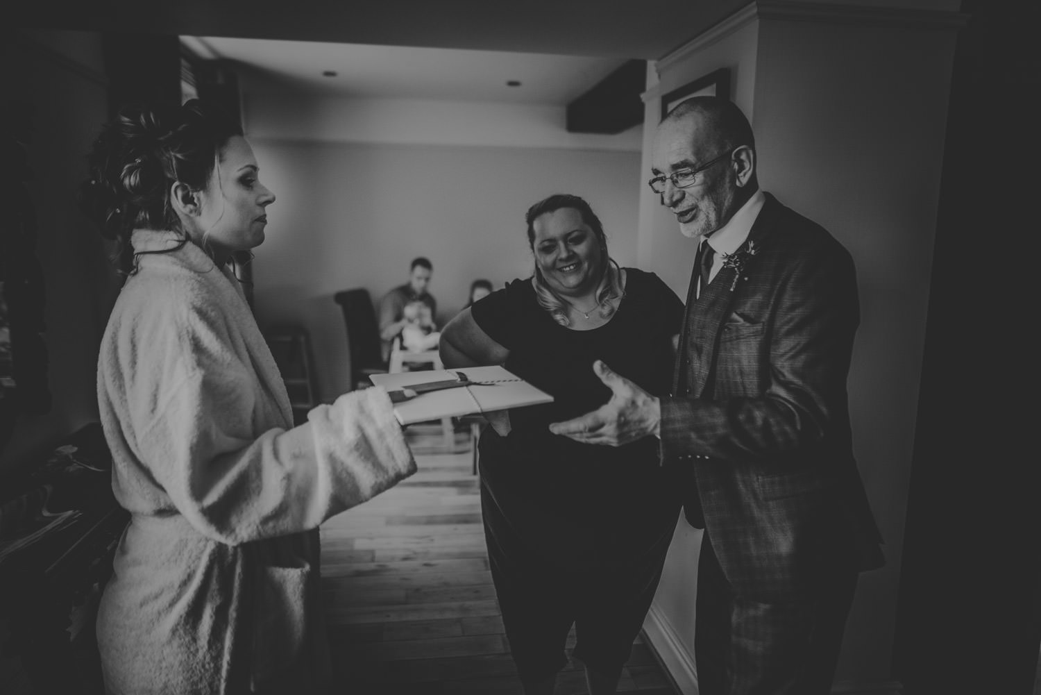 Father of the bride receiving a gift from the bride at Peckforton Castle