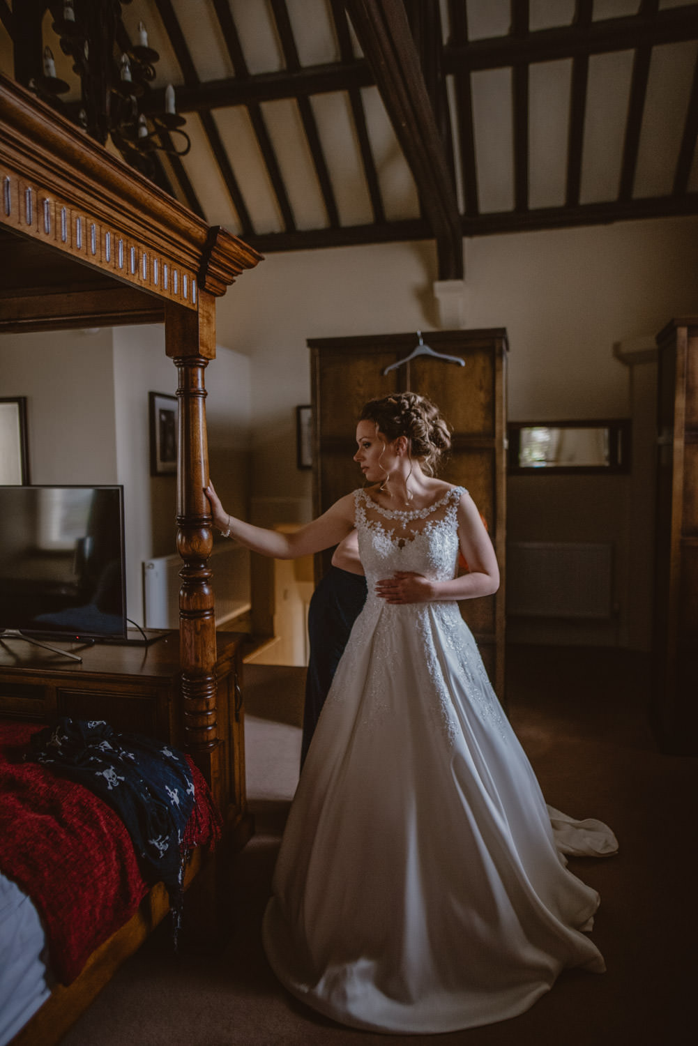 Bride Getting ready at the bridal suite in Peckforton Castle
