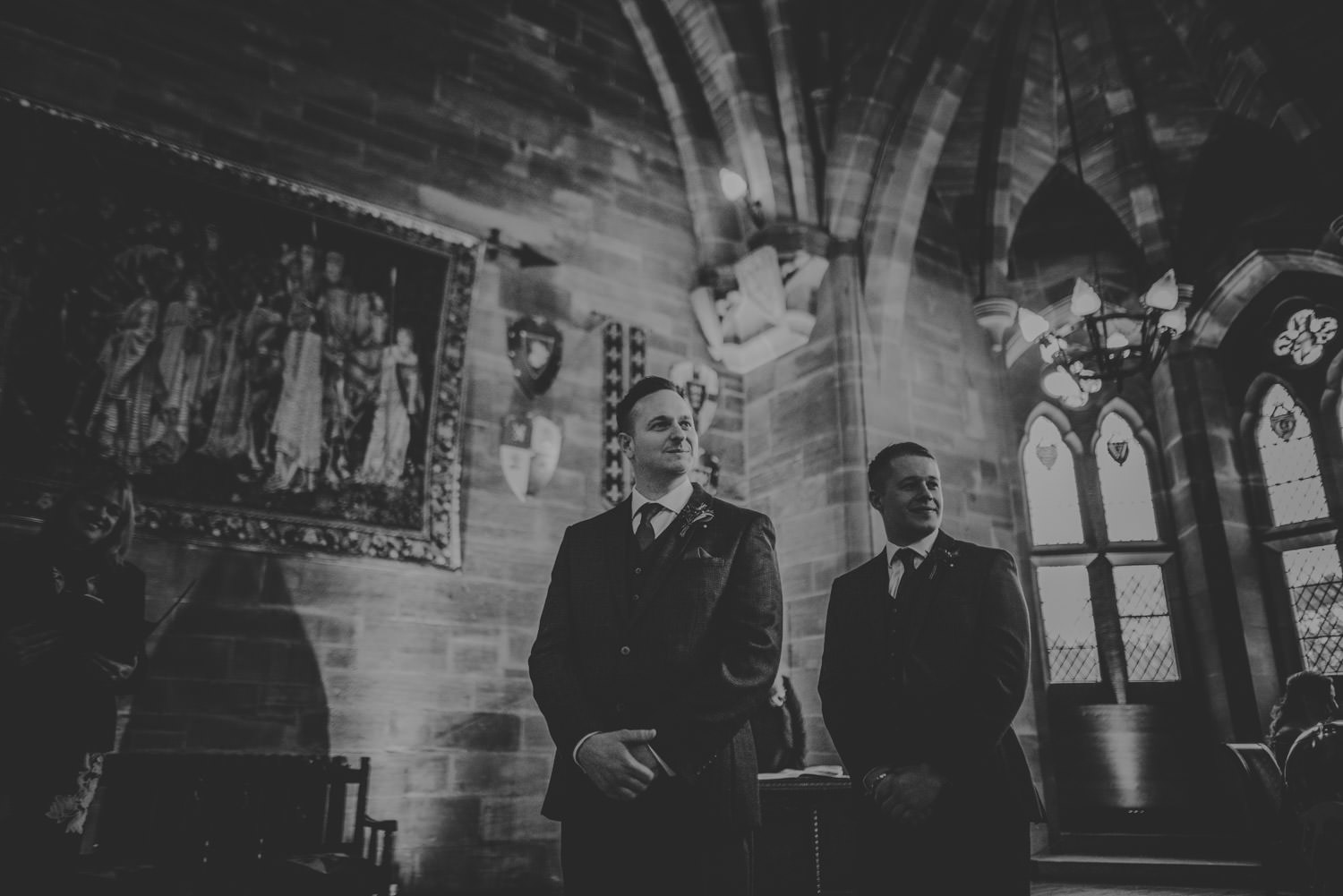 Groom sees the bride for the first time on their wedding day at Peckforton Castle