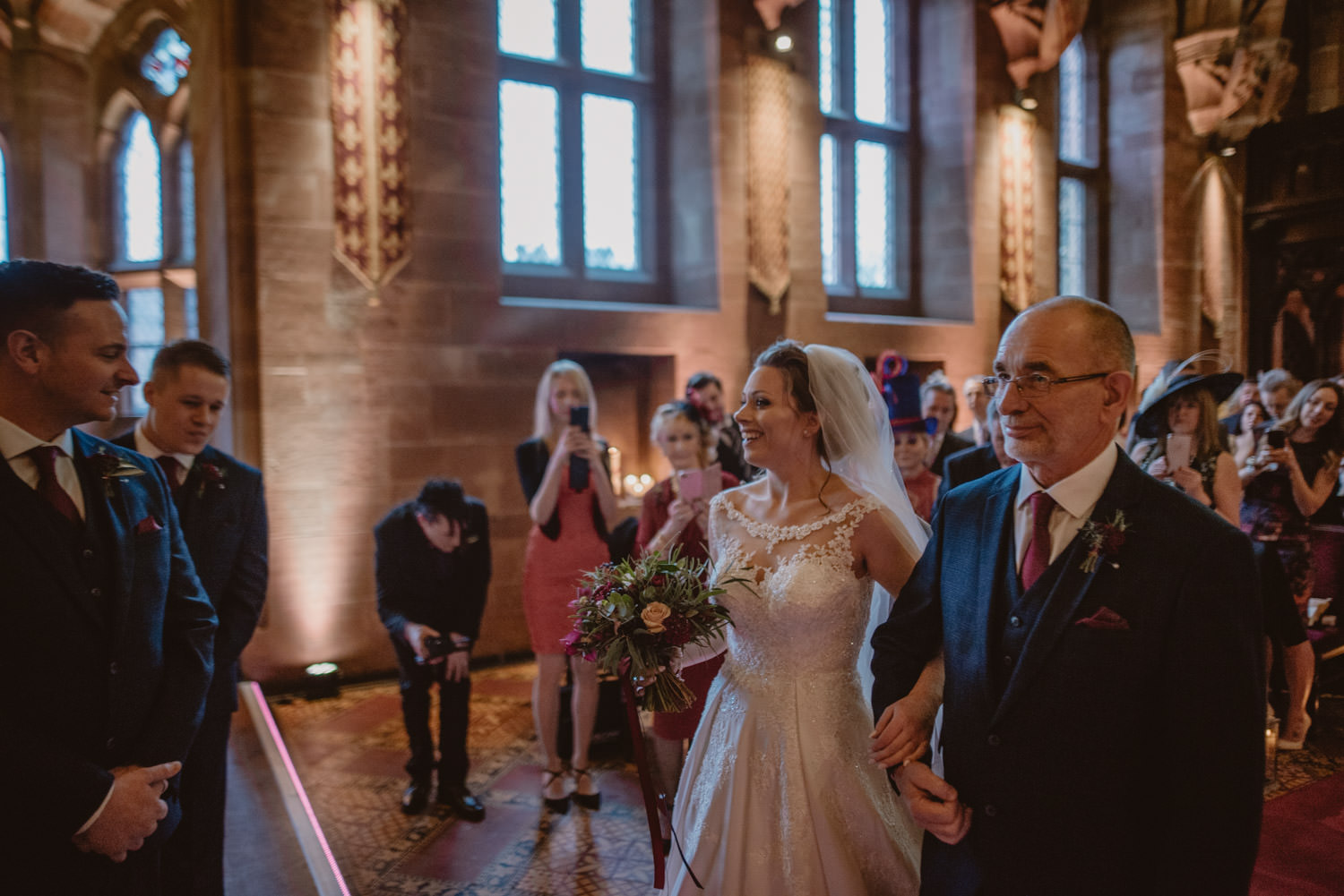 Bride sees her groom for the first time on their wedding day at Peckforton Castle