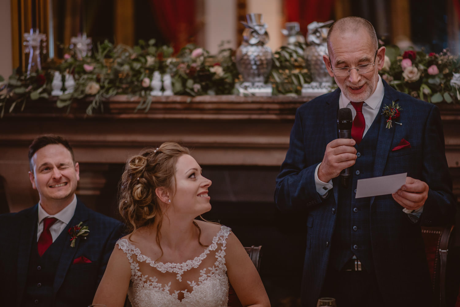 Emotional bride listening to her father's speech on her wedding day at Peckforton Castle