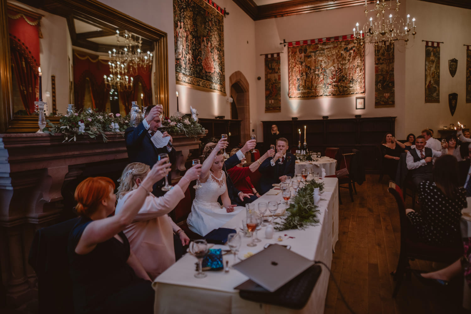 guests toasting at Peckforton Castle during the wedding day