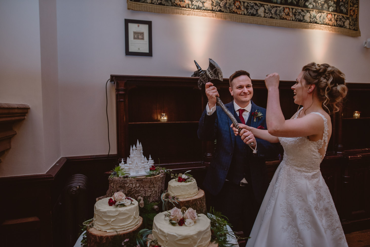 Bride an Groom cutting the cake at Peckforton Castle