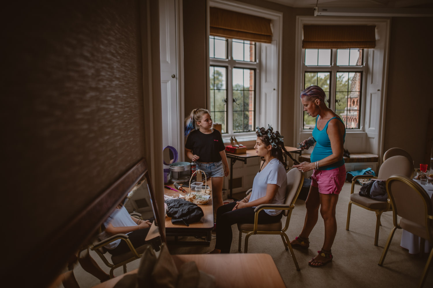 Bridesmaid getting ready at the Seymour Room in The Elvetham Hotel in Hampshire