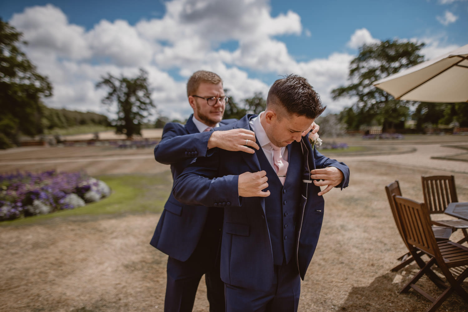 Groomsmen helping the Groom to get ready for the wedding