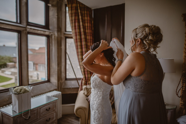 Wedding Dress and Veil by Pronovias