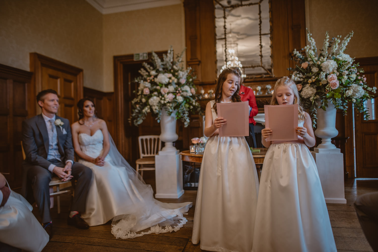 Flower Girls Reading during the wedding ceremony
