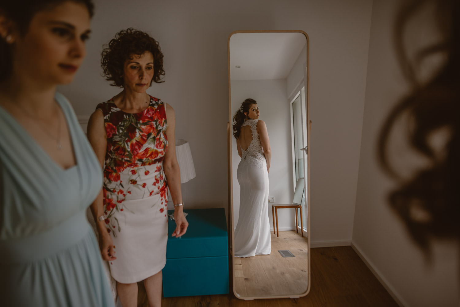 bride seeing herself in a mirror