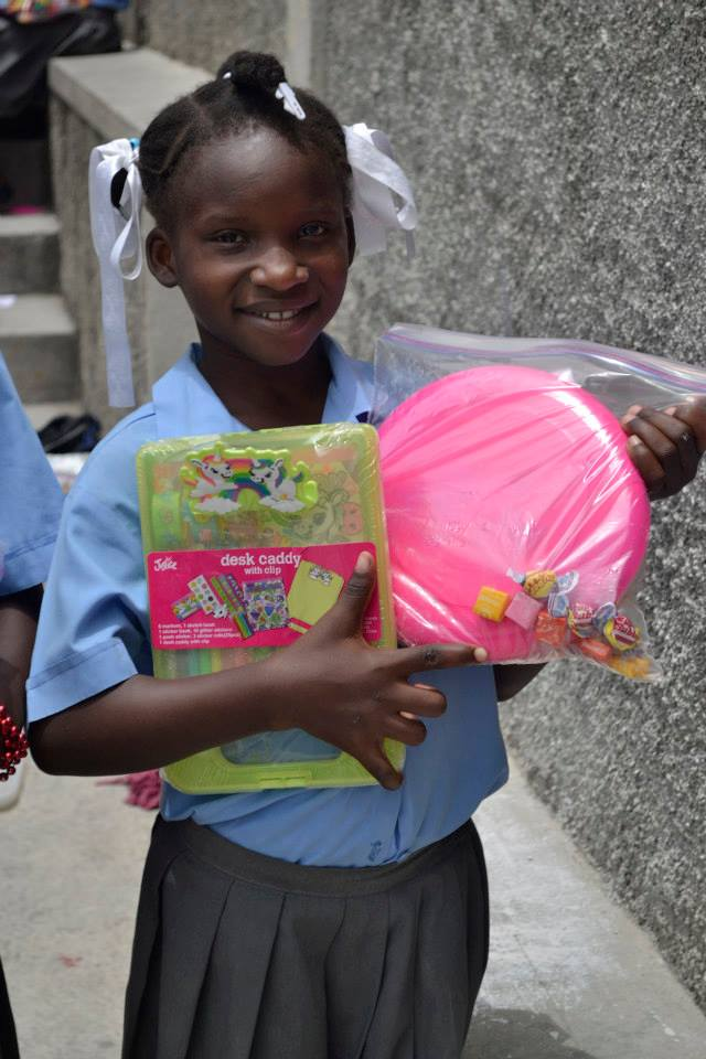 Lovena with gifts from her sponsor