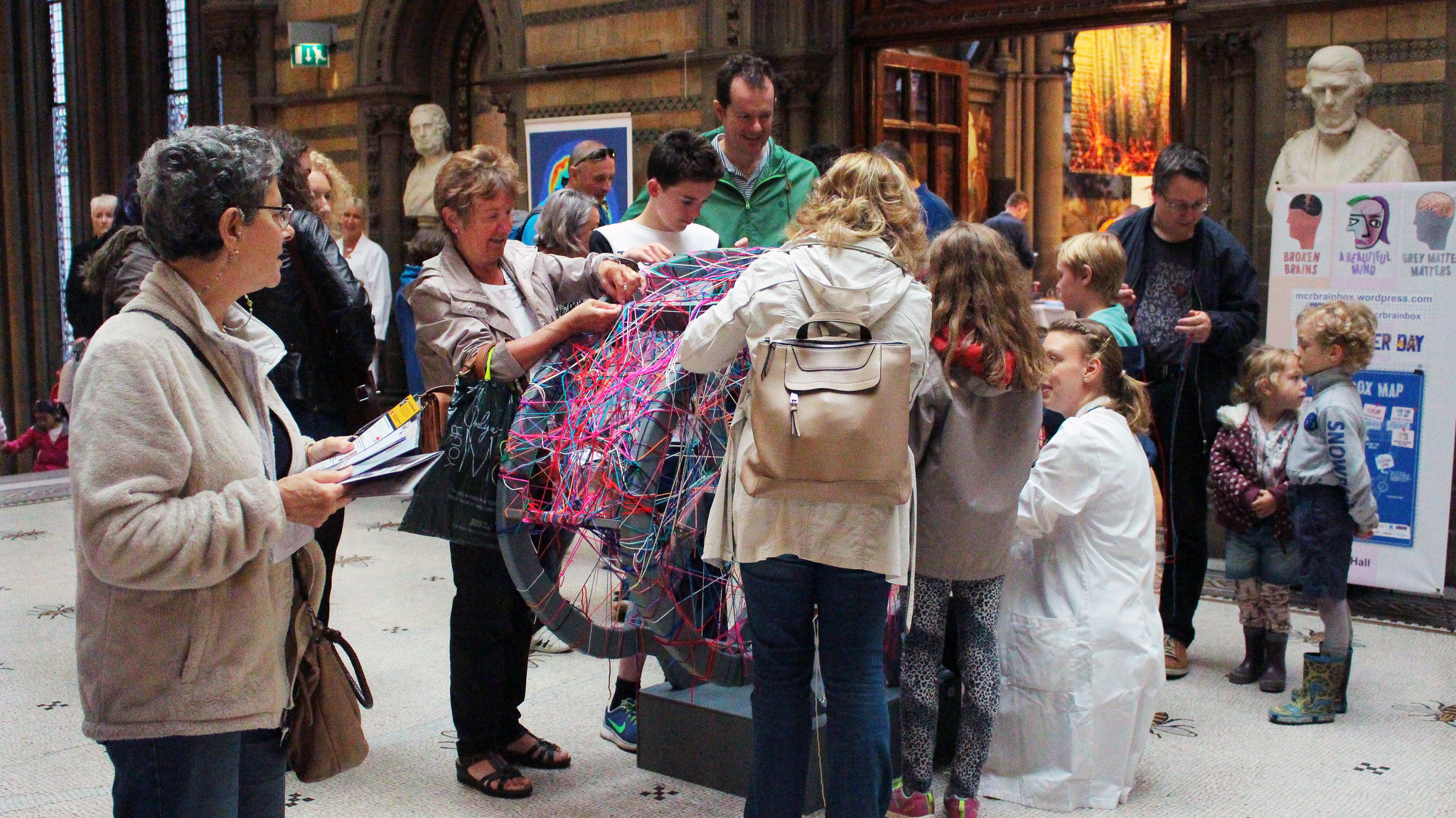 Participants add neurons (wool) to a giant wooden brain, as part of   The Brain Box   event.
