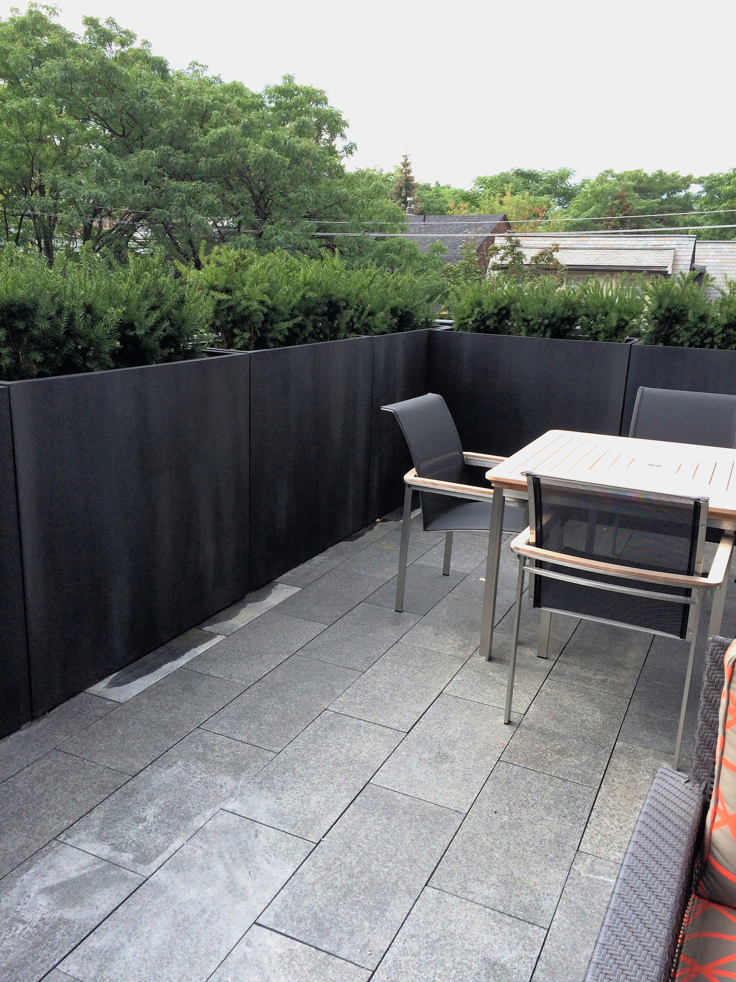 "Planters ""after"" with faux blackened steel paint finish"