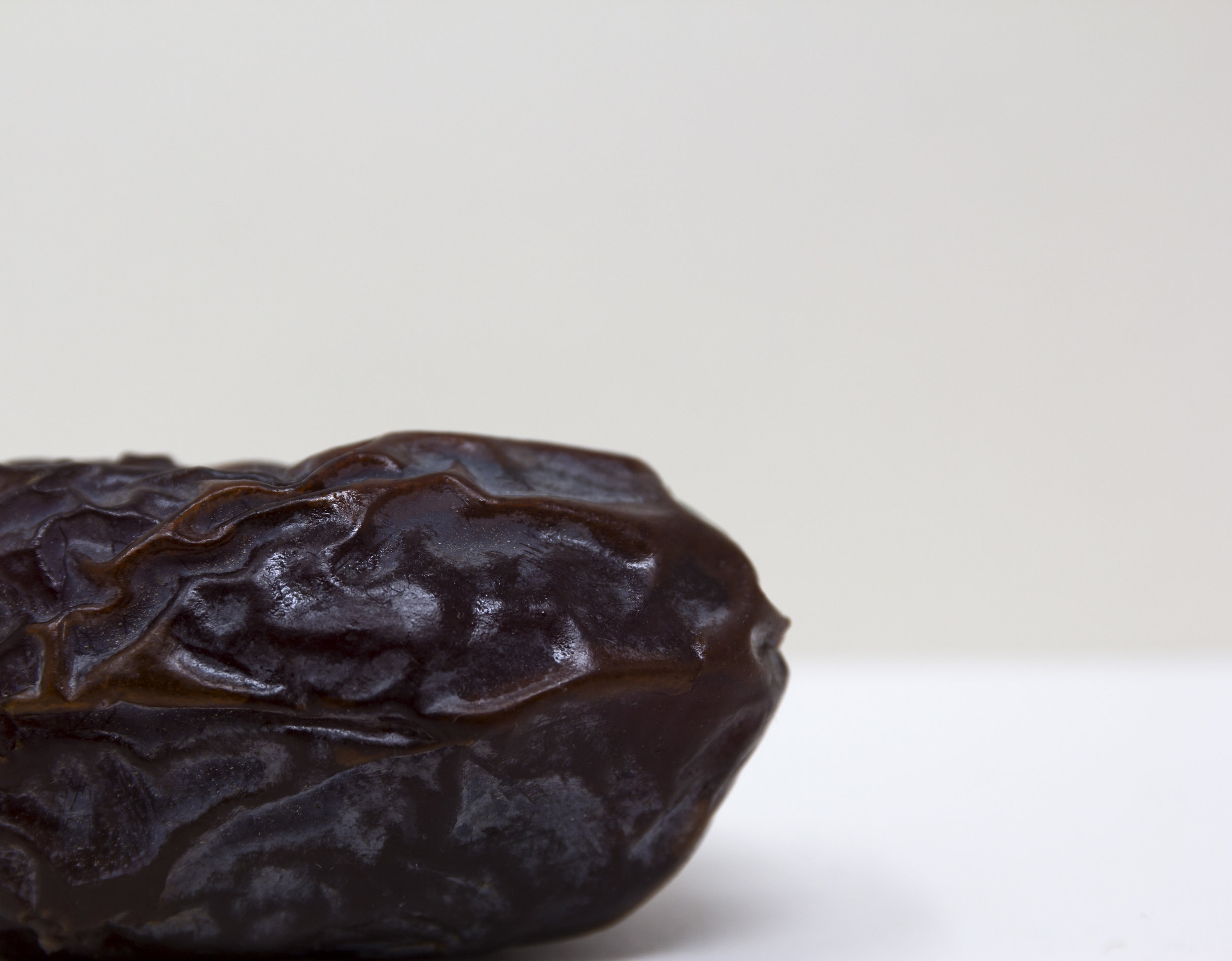 A simple, minimalist, contemporary, fine art clue-up photograph of a date