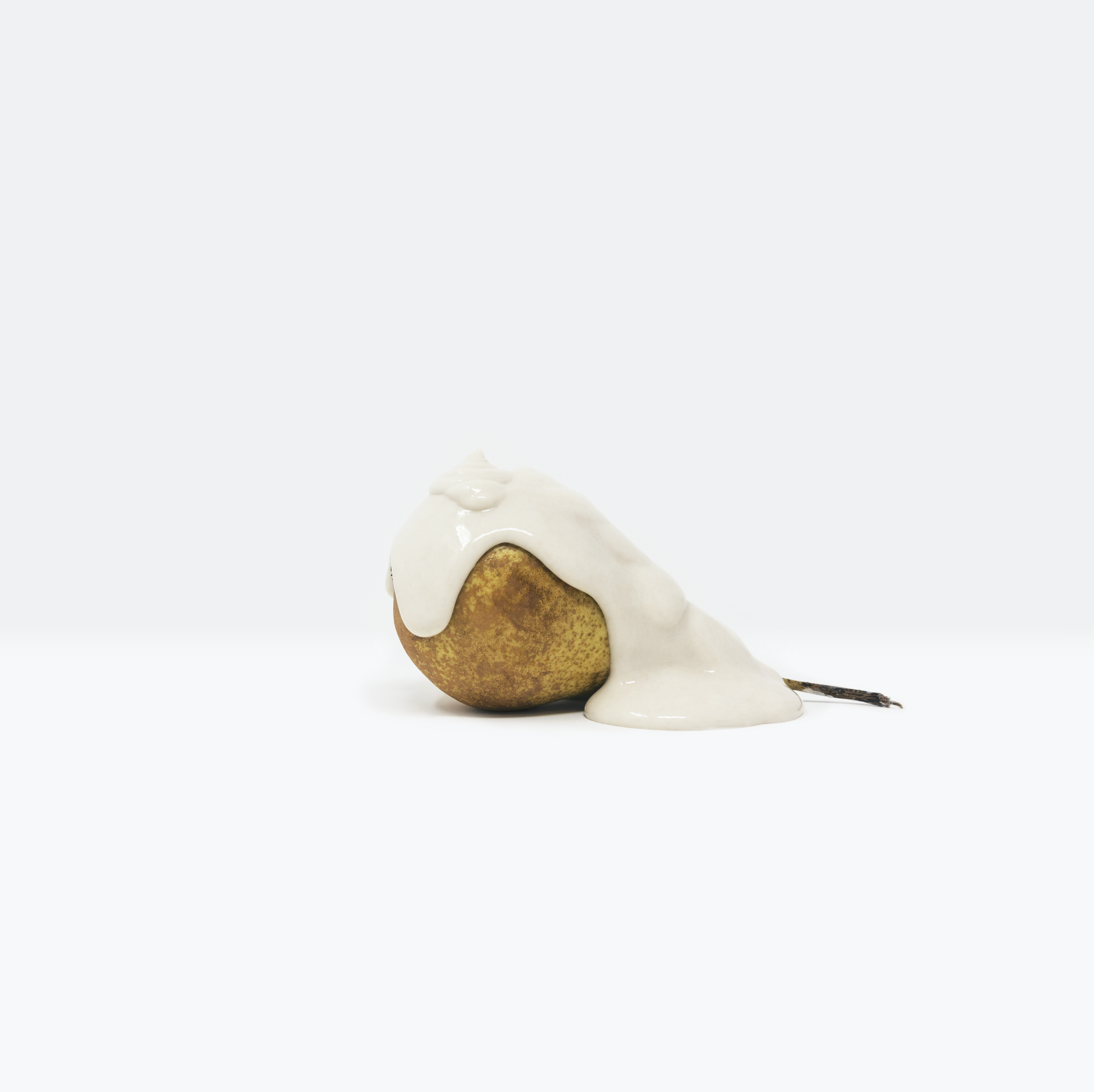 Minimalist, still life photograph of a piece of fruit covered in a paint-like substance highlighting the value of food, evoking the crucial reflection of the Global Food Crisis