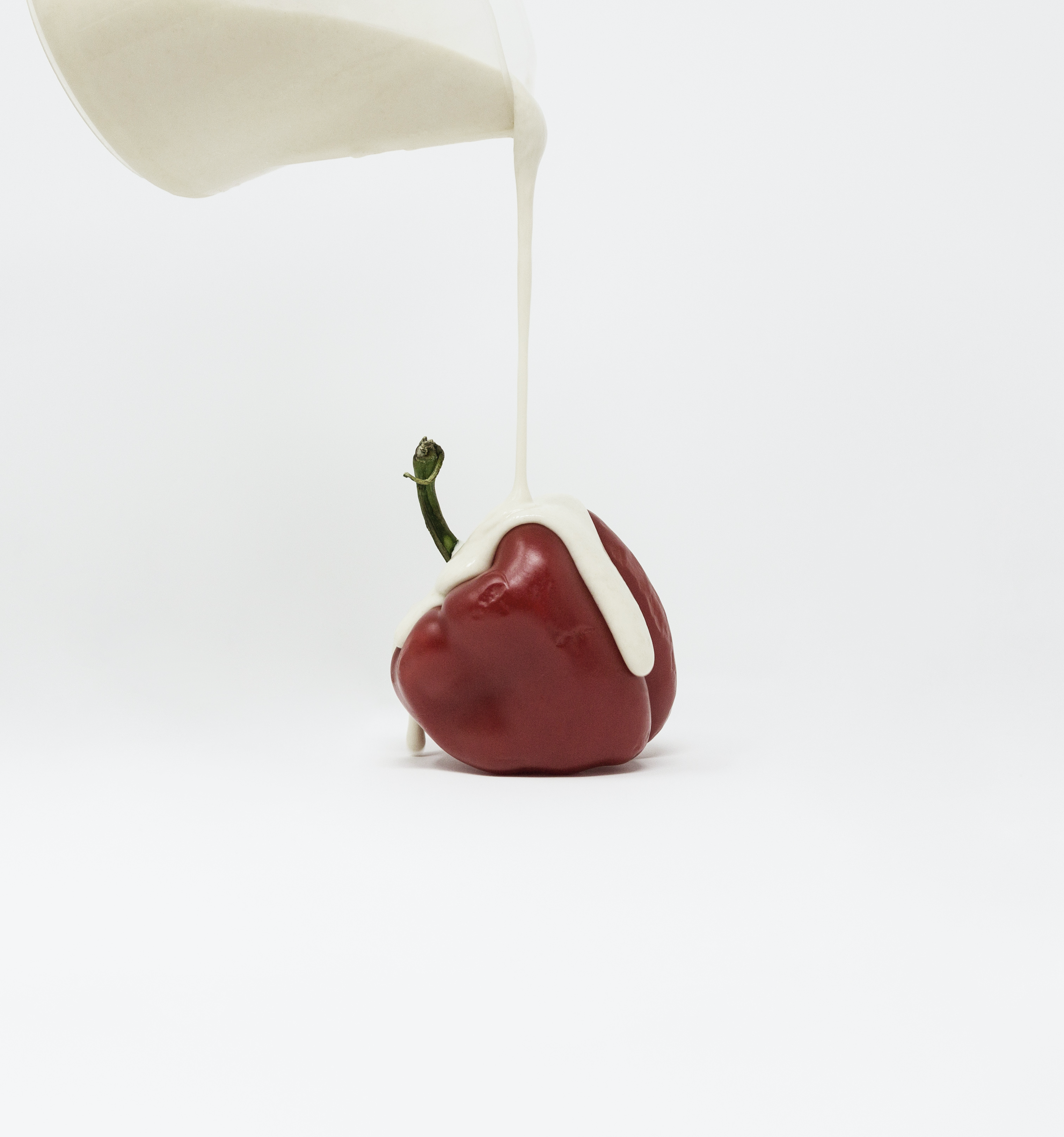 Minimalist, still life photograph of a vegetable covered in a paint-like substance highlighting the value of food, evoking the crucial reflection of the Global Food Crisis