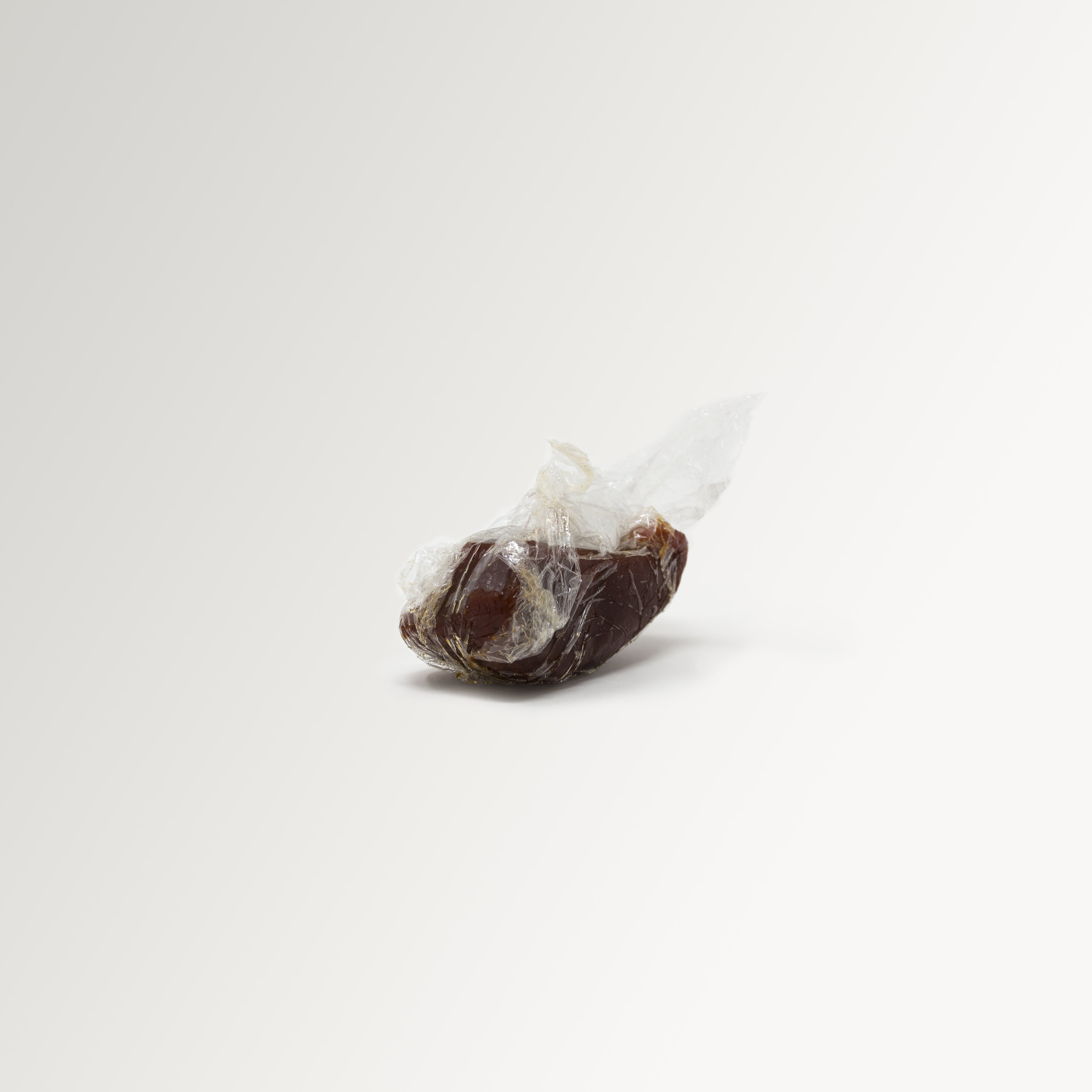 A simple, minimalist, contemporary, fine art photograph of a slice of quince