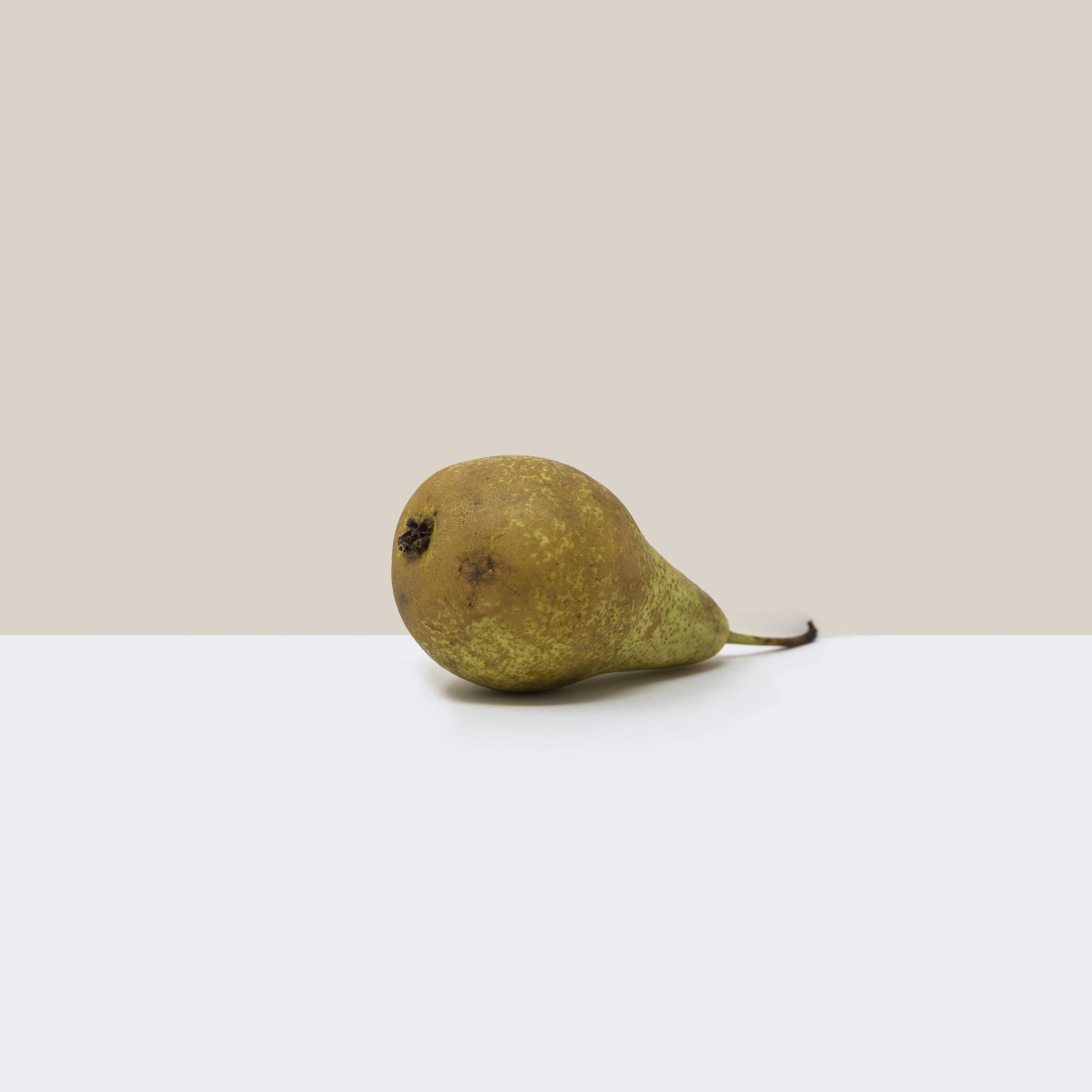 A simple, minimalist, contemporary, fine art photograph of a pear