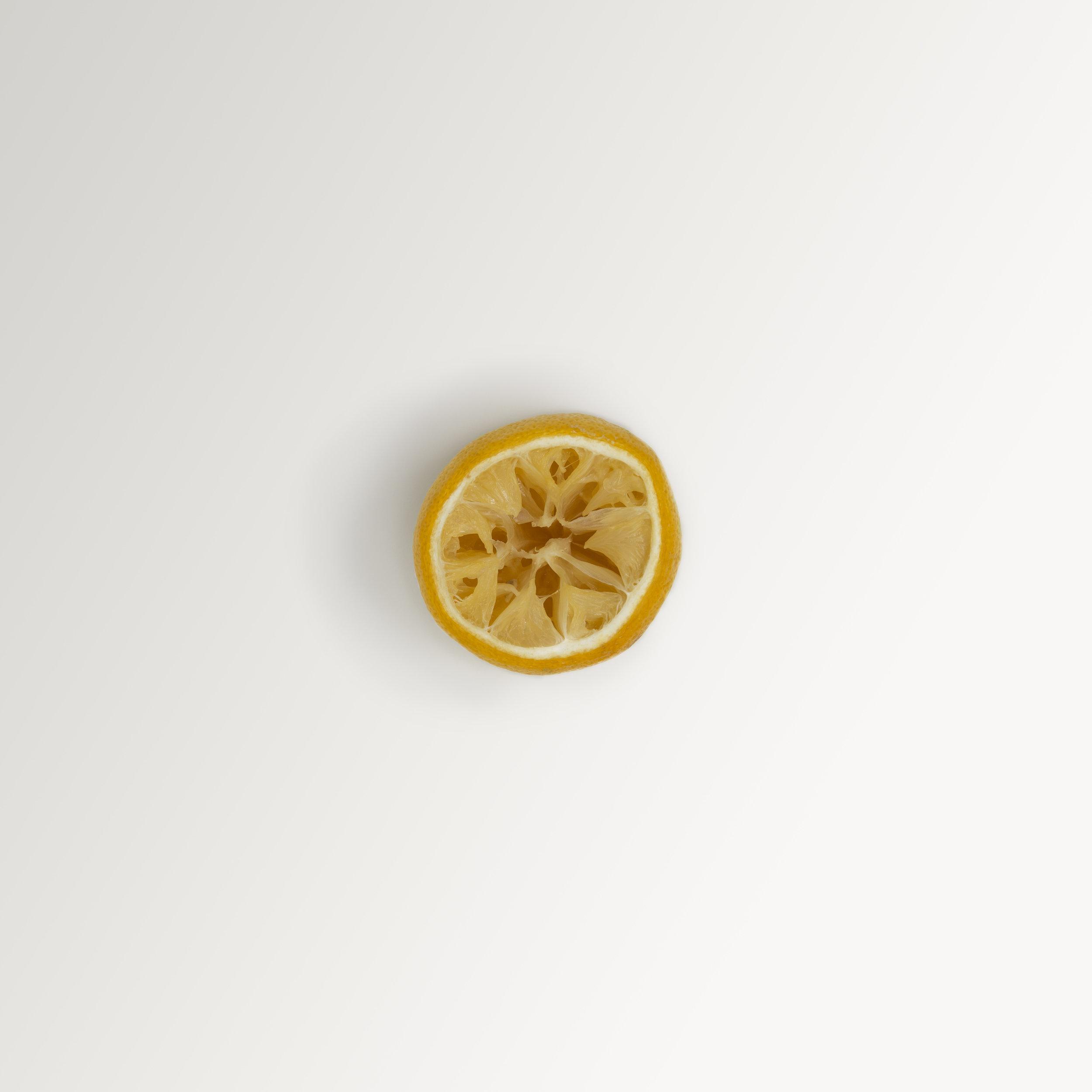 A simple, minimalist, contemporary, fine art photograph of a lemon