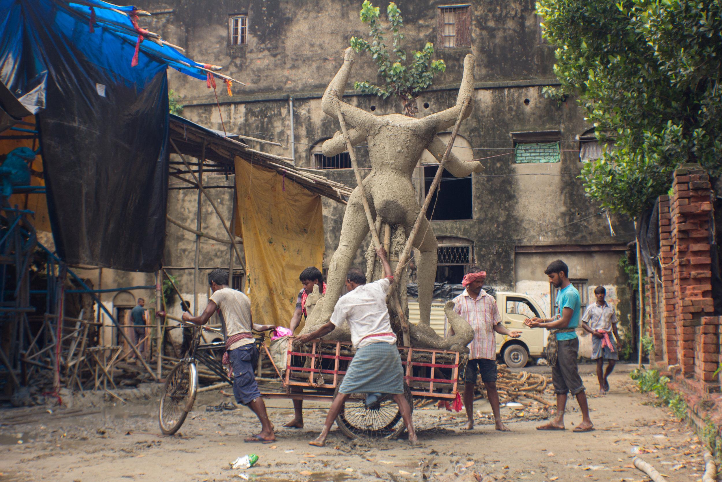 Dalwada vendor, Noida, Uttar Pradesh  General transport (Durga sculpture), Kumortuli, Kolkata