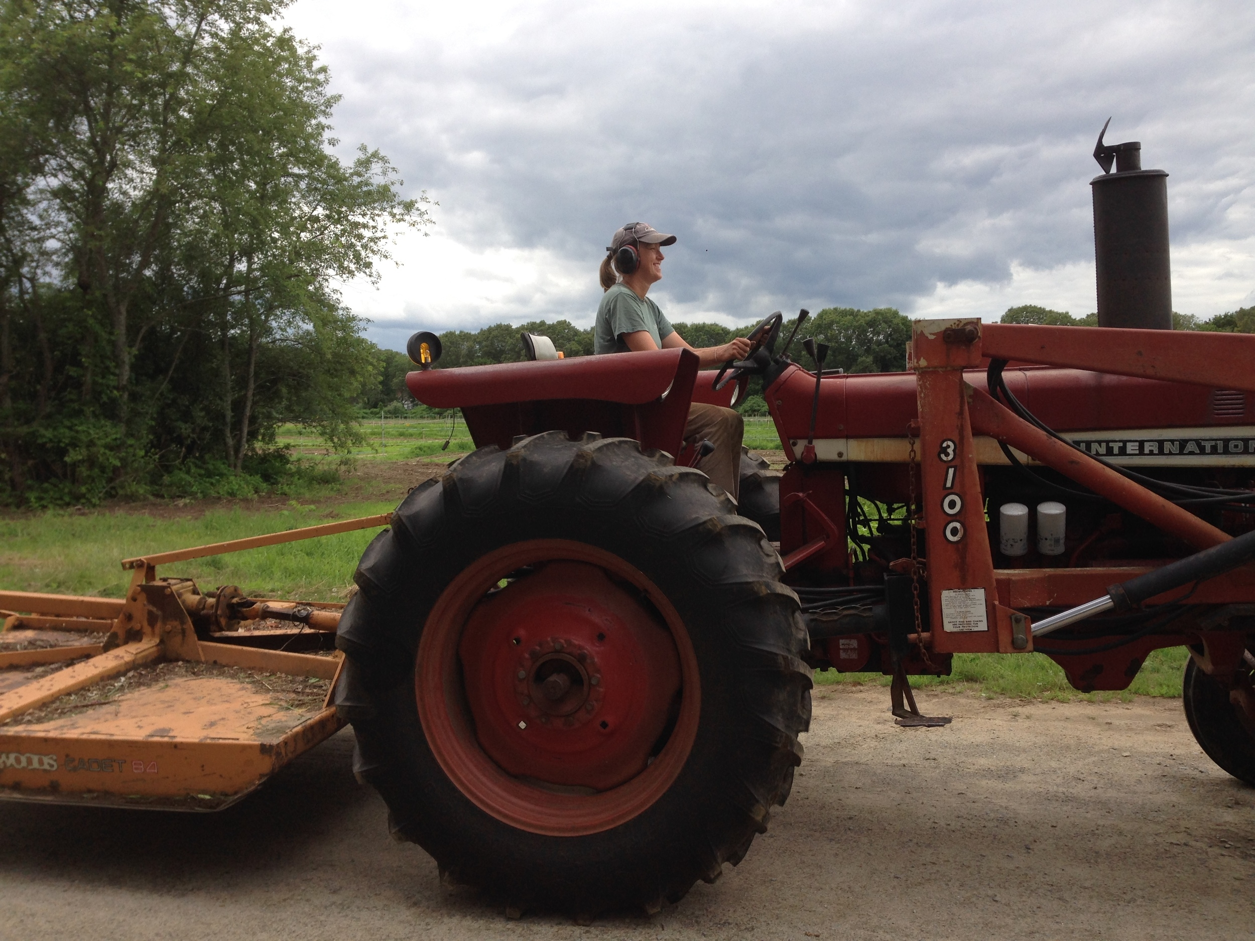 Lise drives out to the fields with the rotary mower