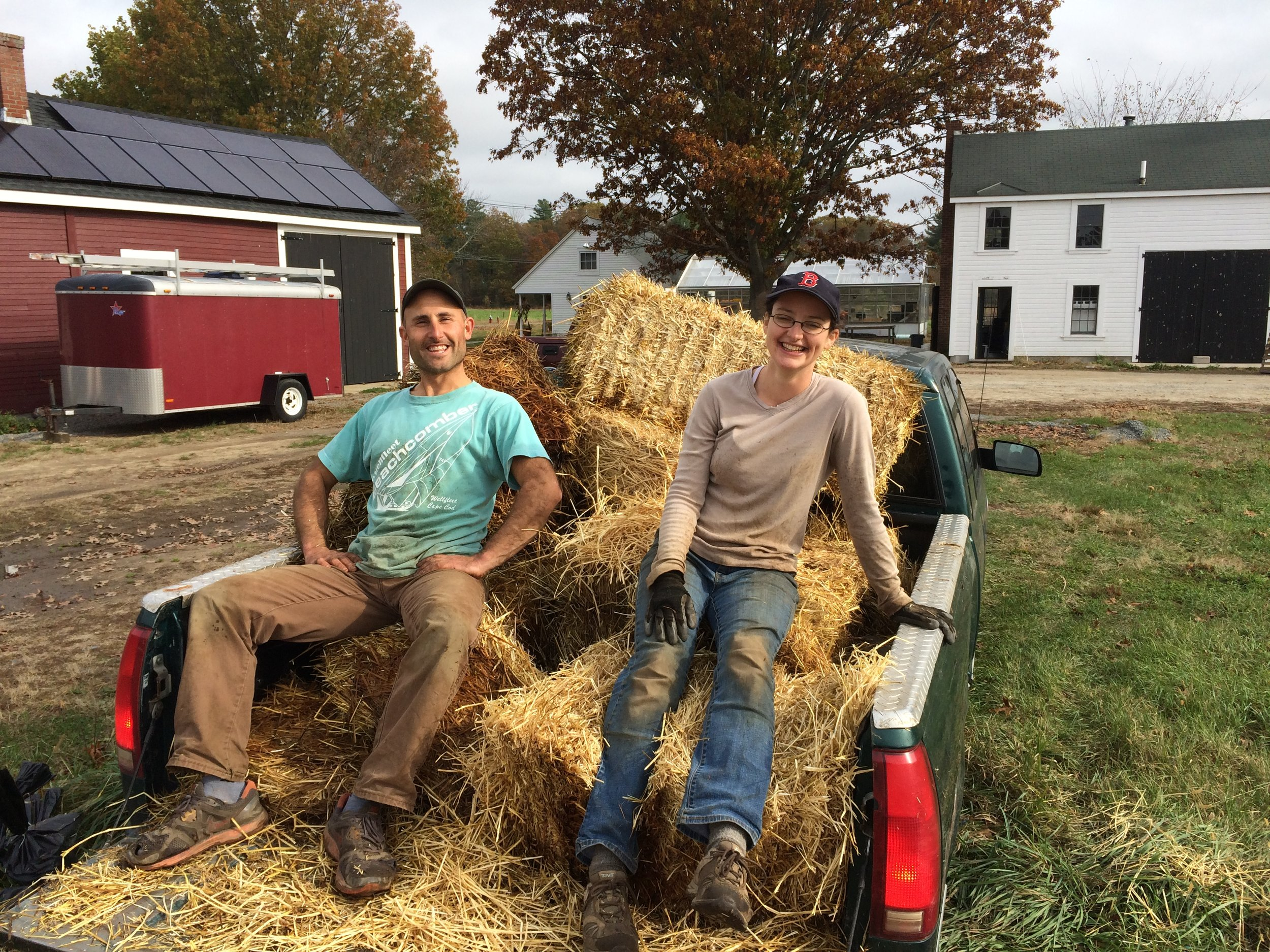 Shaun and Rebecca catching a ride out with the straw to the garlic field. We plant garlic at the end of October and then mulch it with straw to protect it over the winter and suppress weeds in the spring and summer.