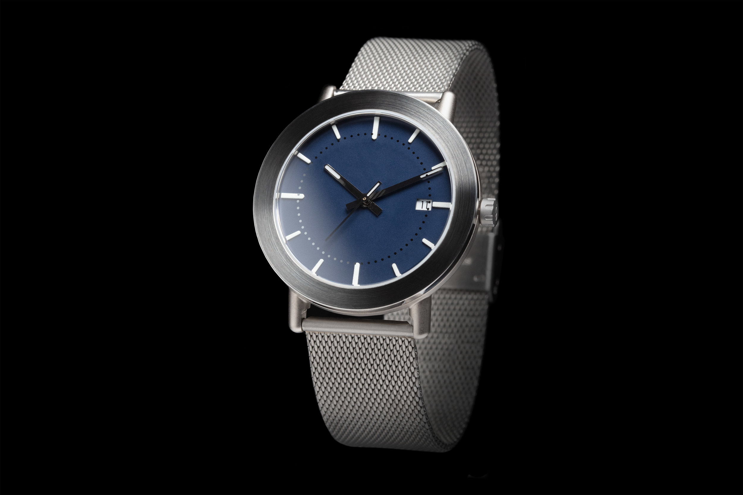 Eleven - A stylish automatic watch available in light or darkgrey, seven different dails, Milanese bands as well as high quality organic leather.