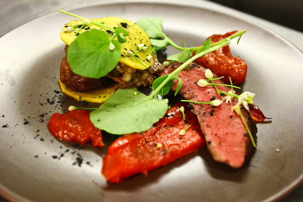 Grilled hangar steak and slow cooke oxtail, pickled beets, roasted peppers, land cress