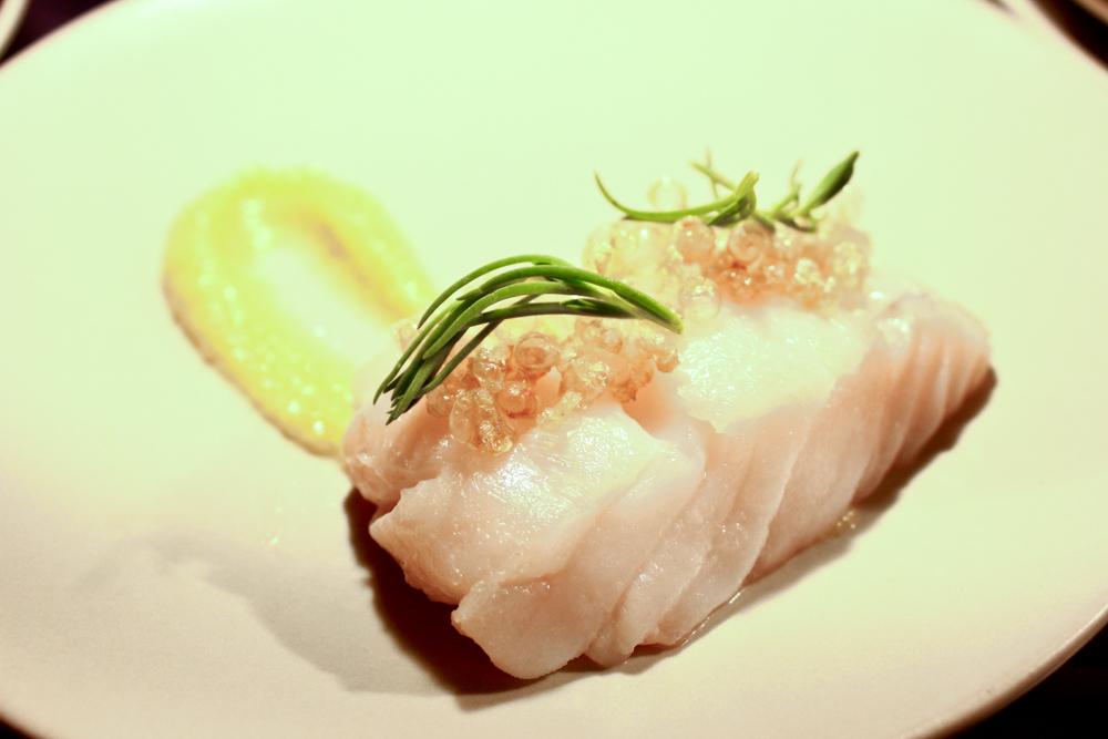 Cod poached in Ibérico fat, lemons, pork skin, sea blite