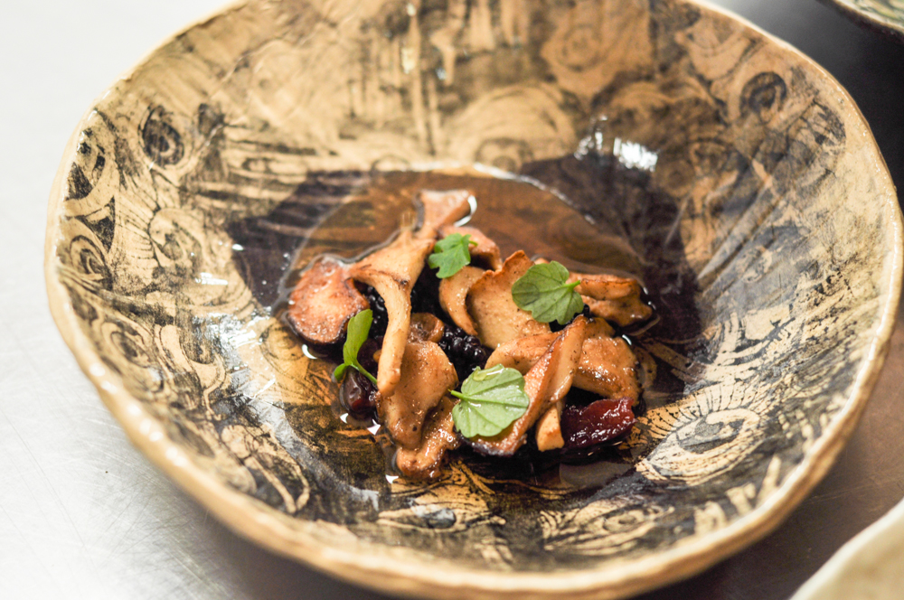 Hedgehog mushrooms, dried fruit, shikabushi/juniper broth in a bowl made by Sashana's mum. ( image -    Alexandra Genis   )