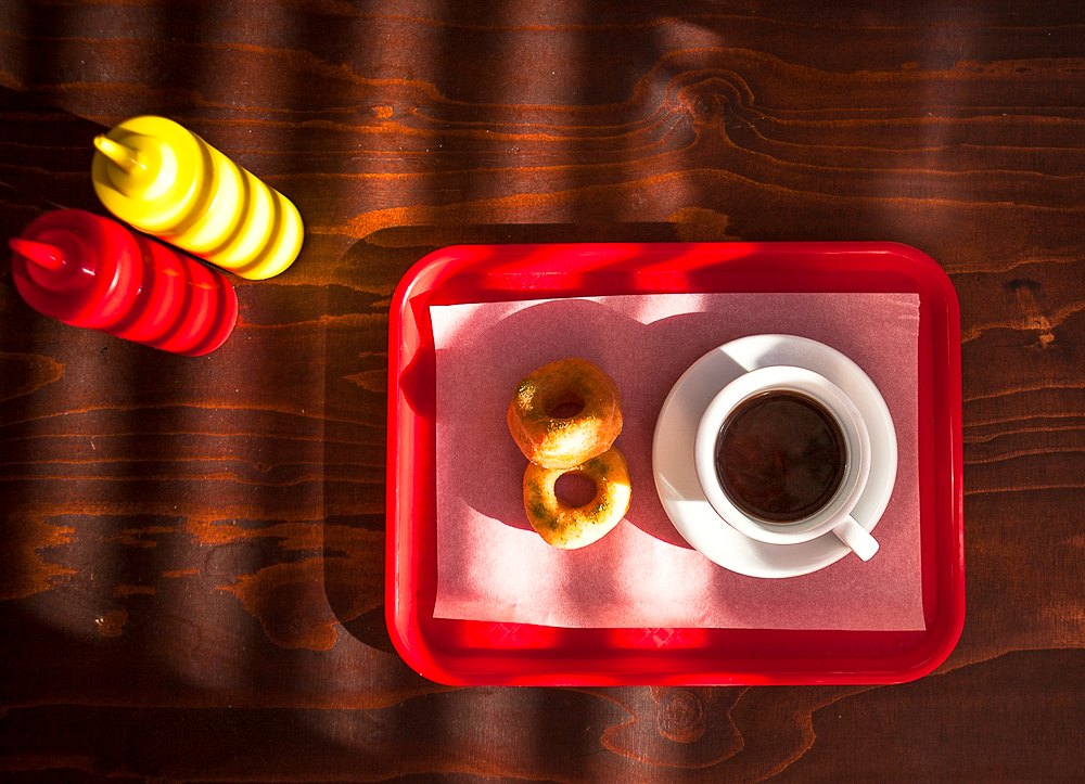 Mushroom and black garlic 'Coffee', savoury donuts dusted with Douglas Fir needle powder