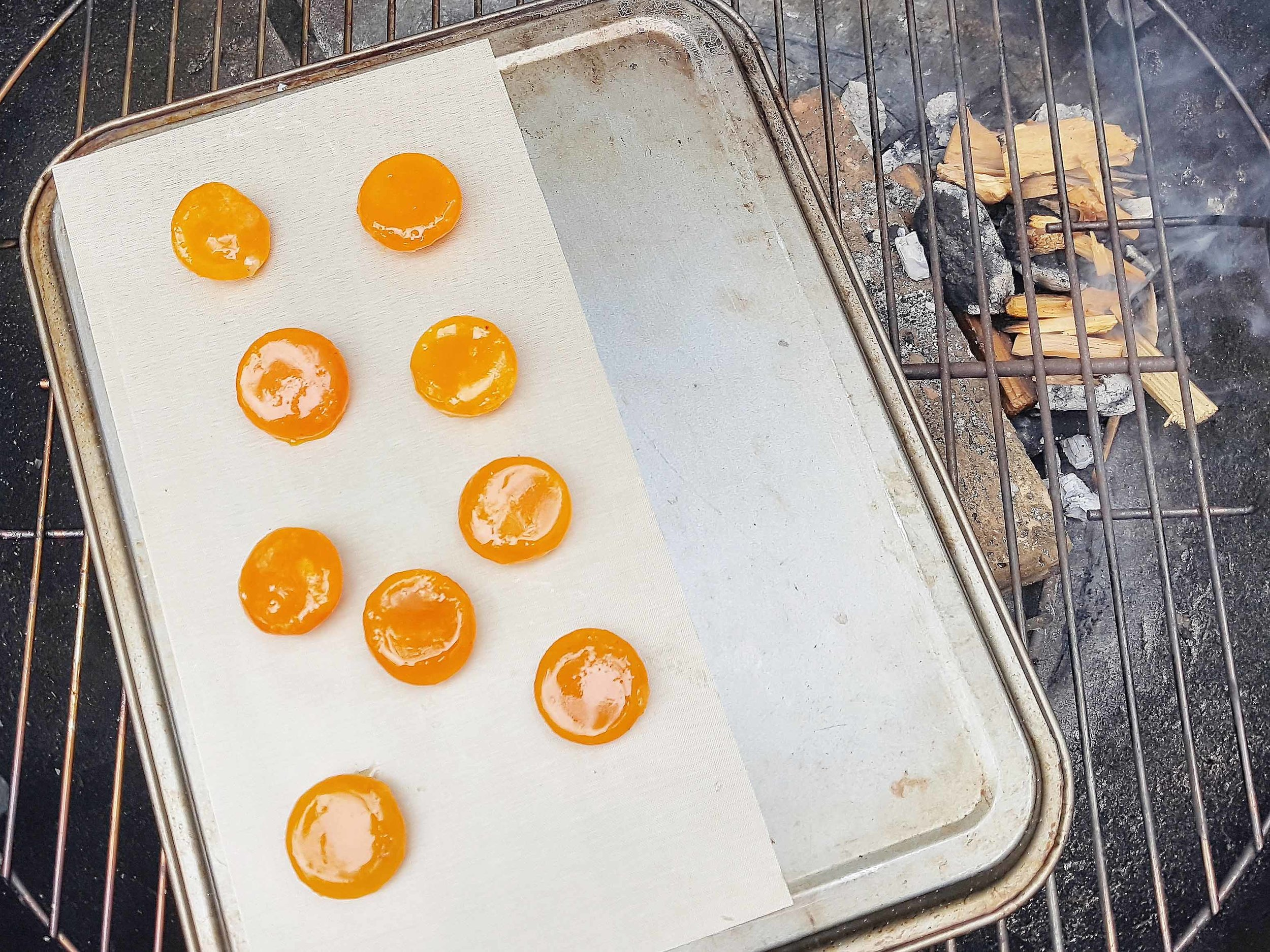 Smoking cured egg yolks over birchwood, August