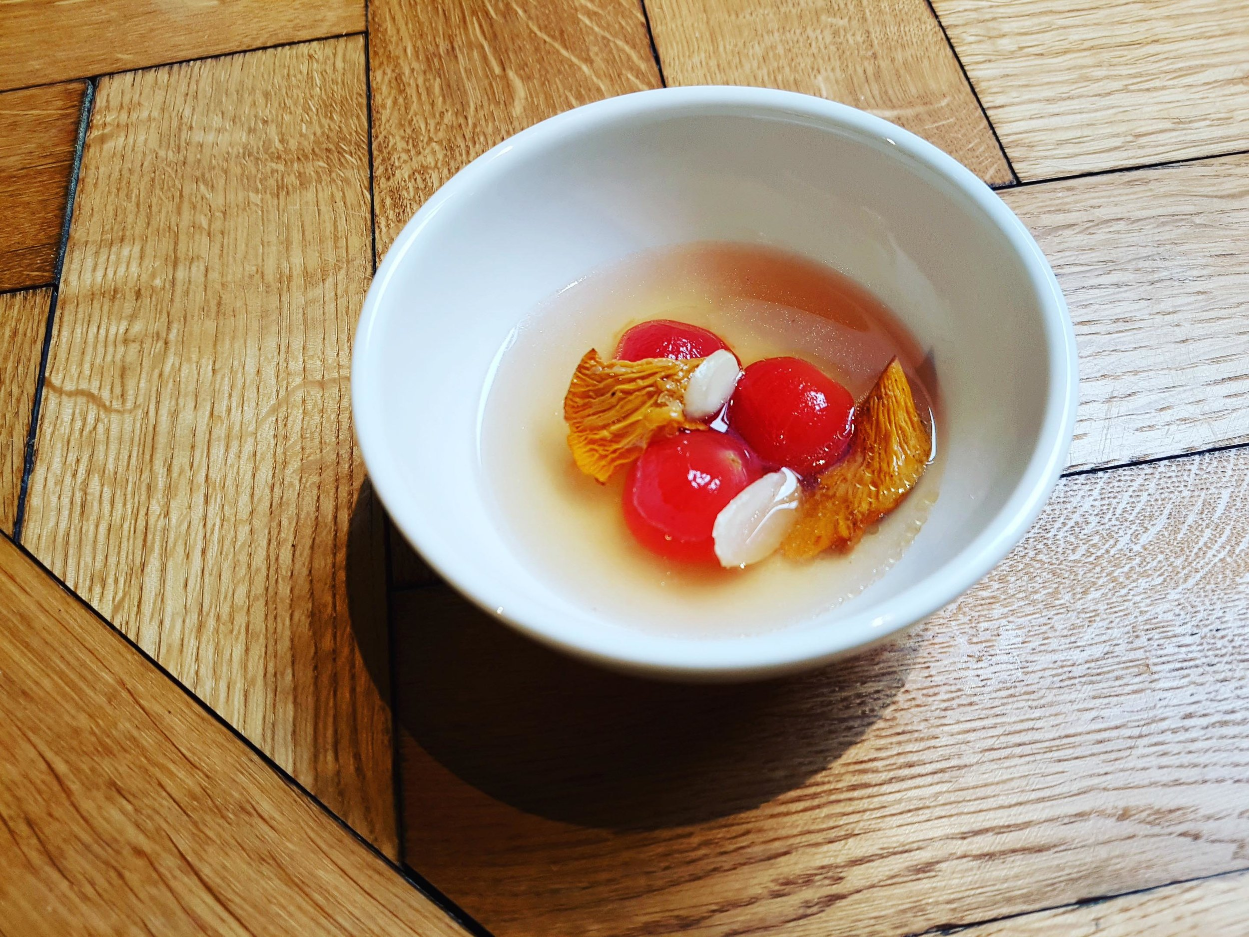 Peeled and semi dried tomatoes, girolles, almonds and bacon broth 'Come Closer' breakfast for Moooi, September
