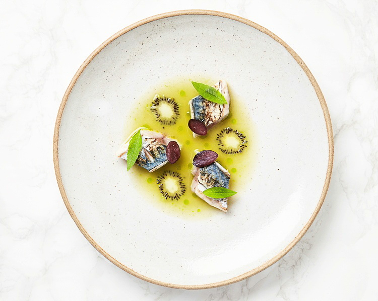 Charred mackerel, kiwi kombucha sauce, dried Kalamata olives, lemon verbena Simba dinner, Ibiza, June  (image by  Louise Hagger