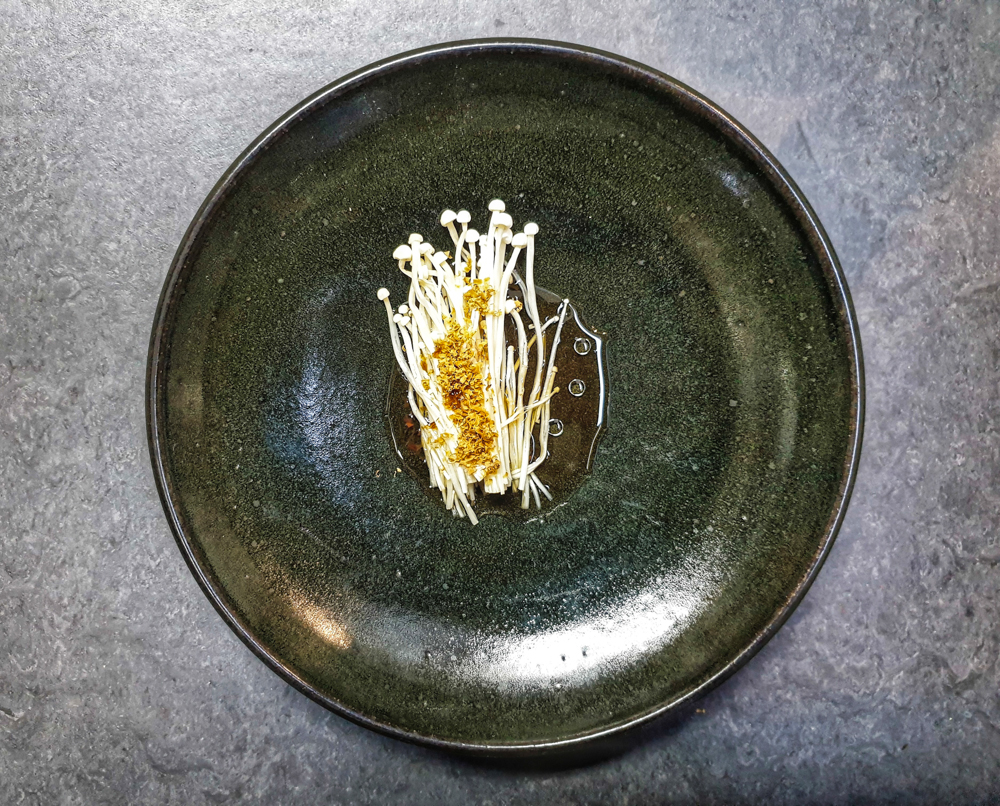 Our monthly Test Kitchen dinners return on  Friday 22nd & Saturday 23rd February .  These evenings are a way to share with you what we're working on month to month. The last few months we have been learning about and experimenting with the 'wonder mould' Aspergillus oryzae, aka koji .  As such, our title for the month is  New to Koji.   This amazing ingredient can be used to transform grains and legumes into more complex and tasty versions of themselves, developing their potential sweetness and umami. The dinner will feature several uses of koji, including umami sauces made from egg whites and from polypore mushrooms.  Alongside these processes, Josh is sourcing Mangalitsa breed pork from Wales which will be served with black apples (think  black garlic ) and Mike is working on a dessert at the meeting point of Danish choco-rye bread and mint-choc-chip. We are also developing a few small runs of products such as garums and shoyus and will have a few samples for you to taste on the night.  We have released dates for the coming months too, available on our  events page . Tickets are £48 for the full menu and a glass of fizz to start.    Menu   Snacks, B & S sourdough breads & cultured butter  Enoki mushrooms & egg amino  Beetroots, polypore shoyu & sorrel  BBQ squid, chicory & damsons  Mangalitsa pork, black apples & green elderberries  Chocolate and koji rye bread, cultured cream, cacao husk & mint