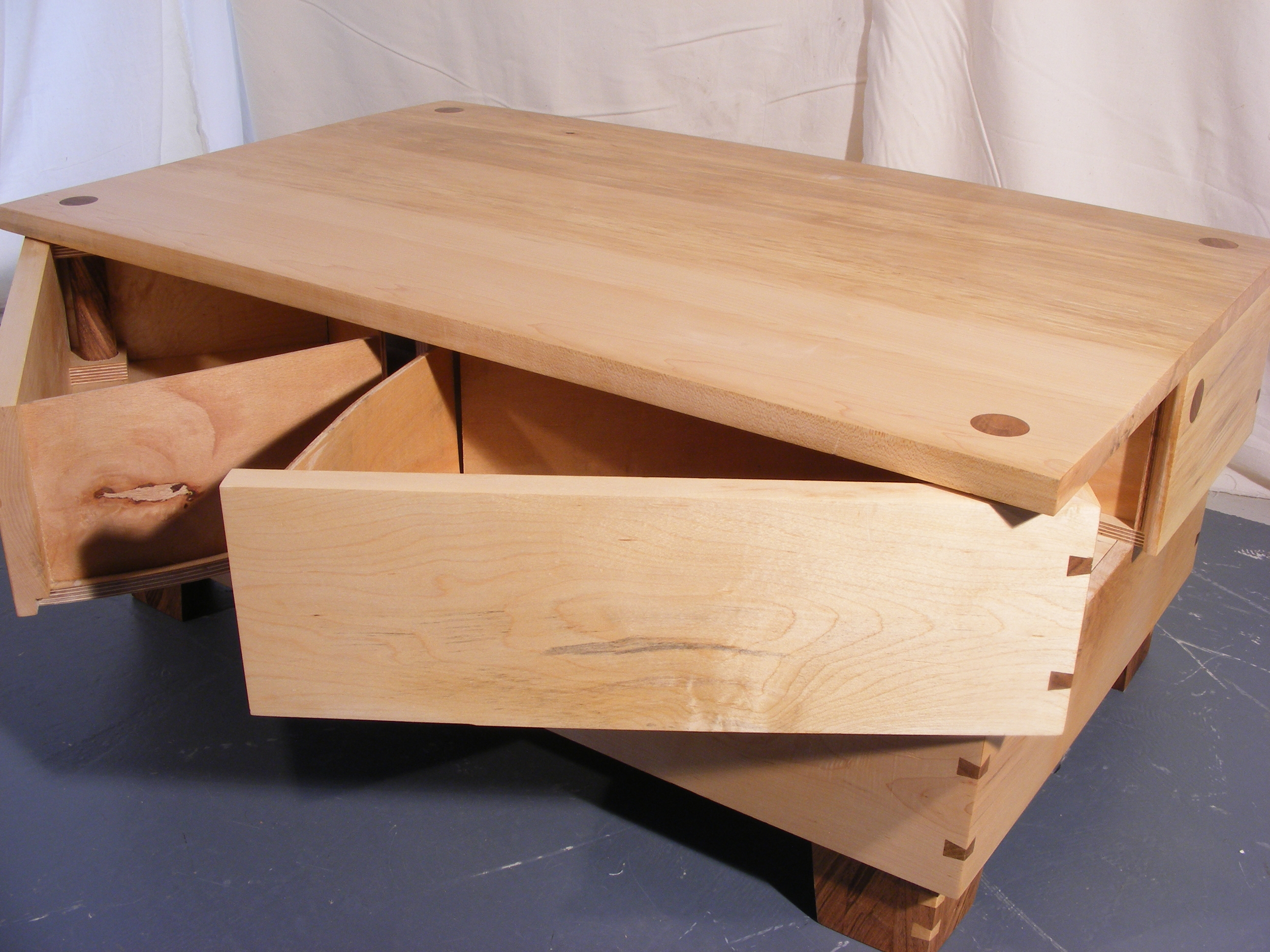 Pivoting coffe table drawers