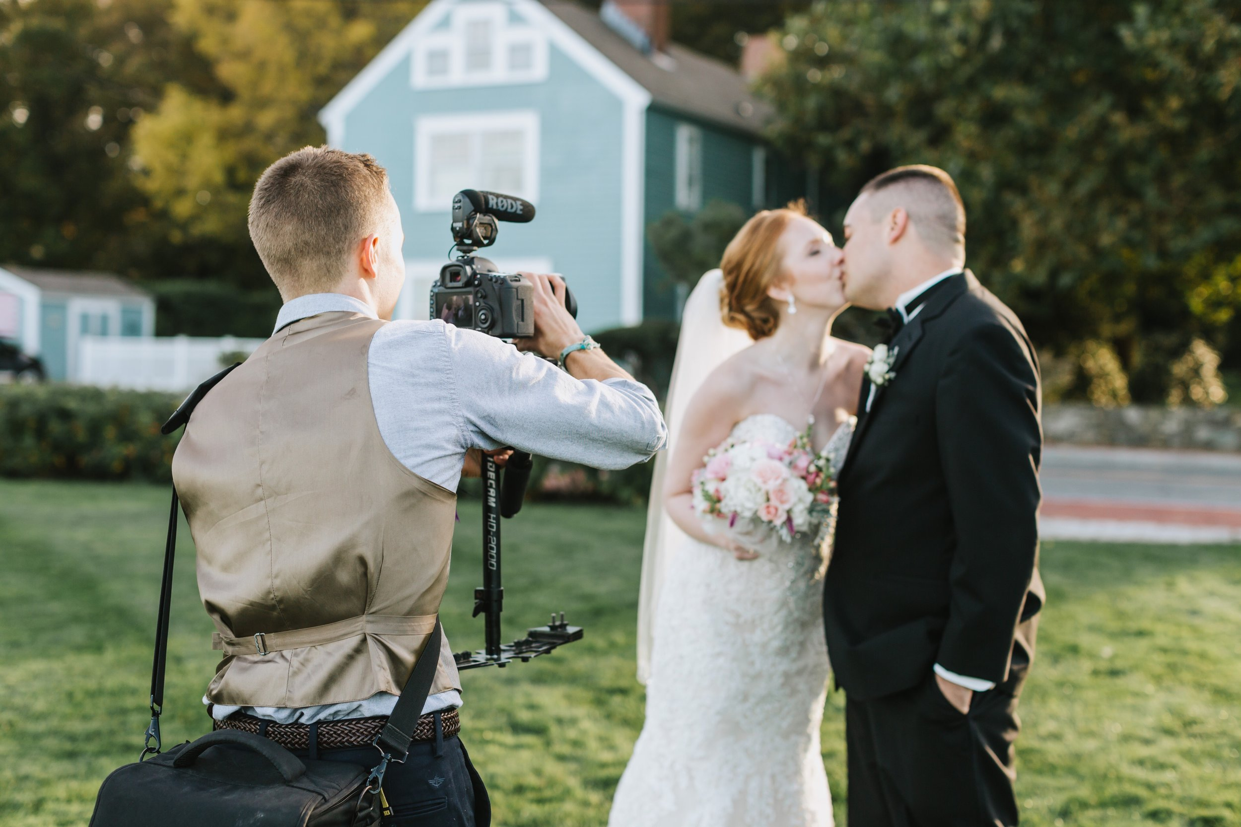 One of our videographers, Brendan, capturing a special moment between Andrea & Dan during a beautiful shoot in Newburyport, MA.  Photo credit:  Lena Mirasola  Photography.