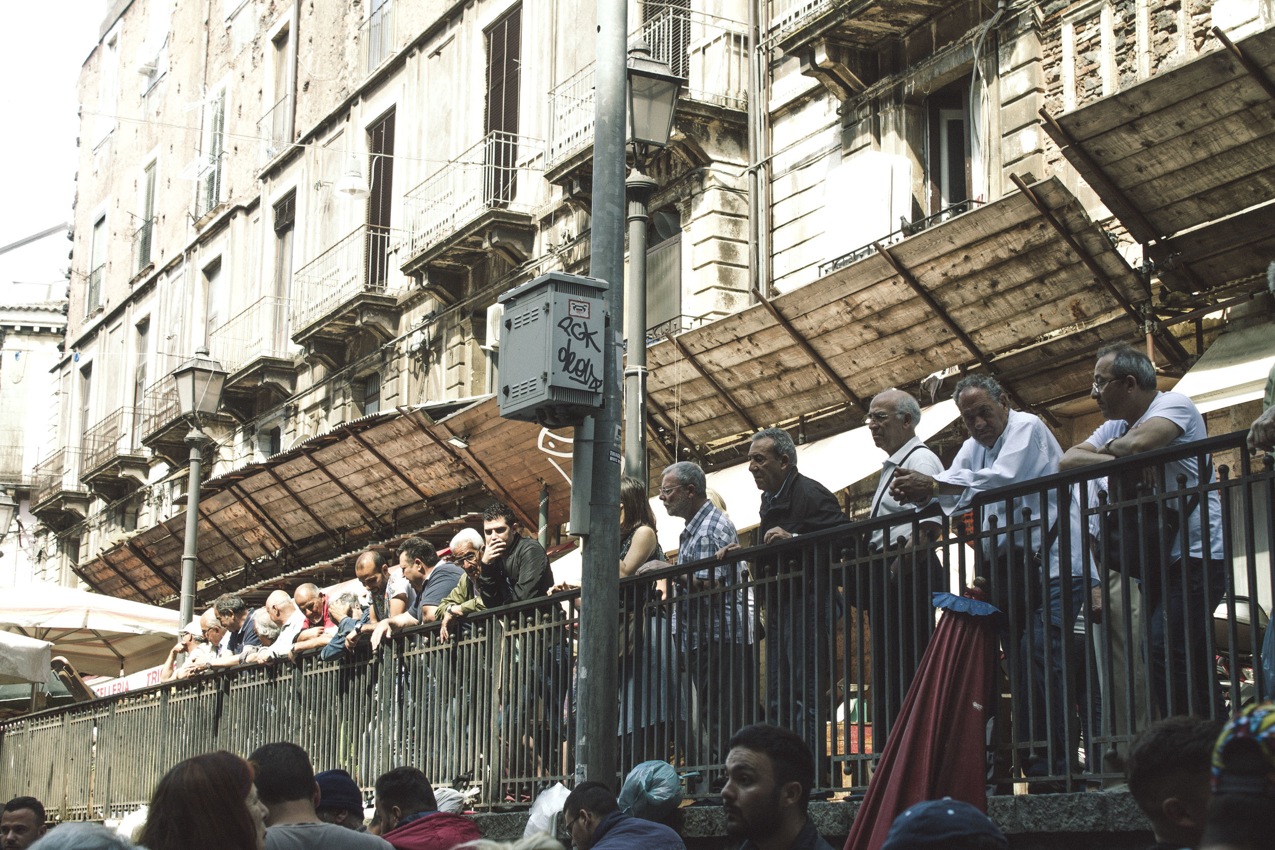 Locals watch the spectacle that is Catania's fish market