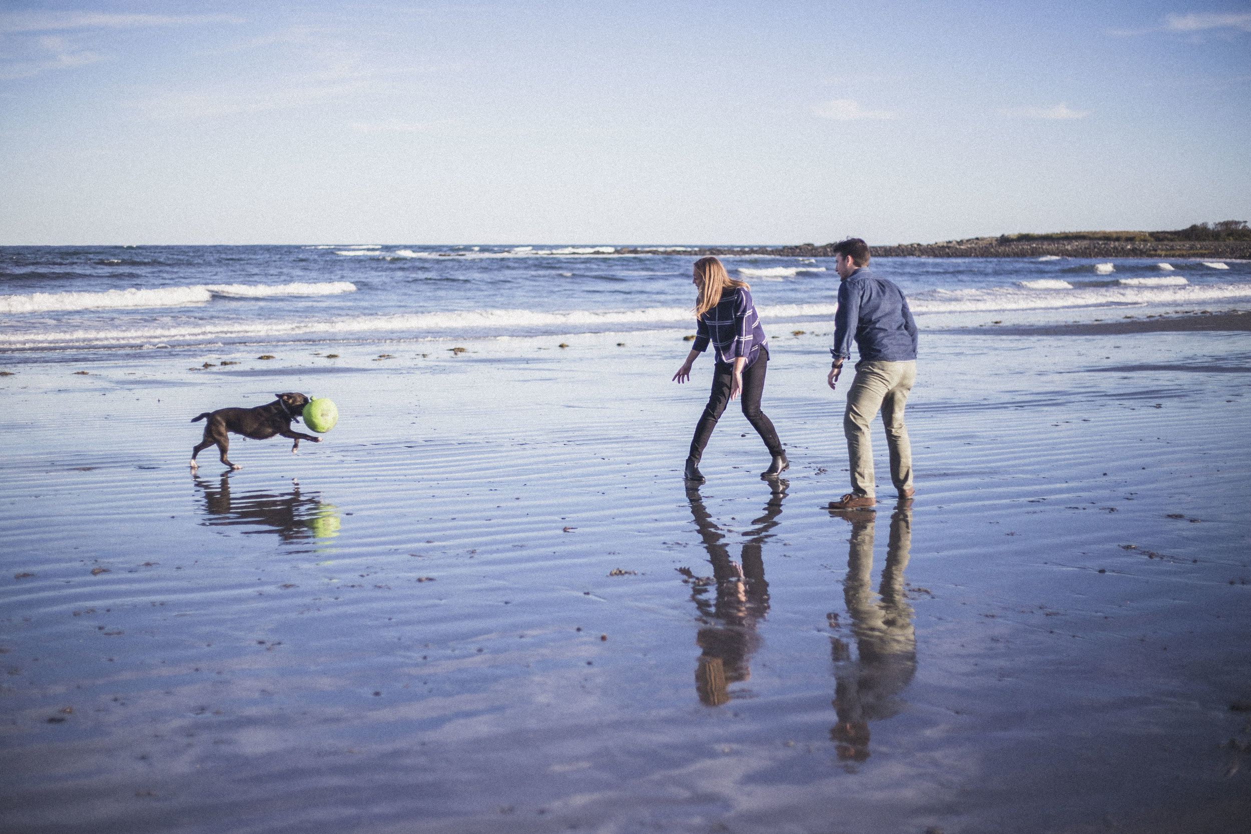 A couple shoot with their dog at Seapoint beach in Kittery, Maine
