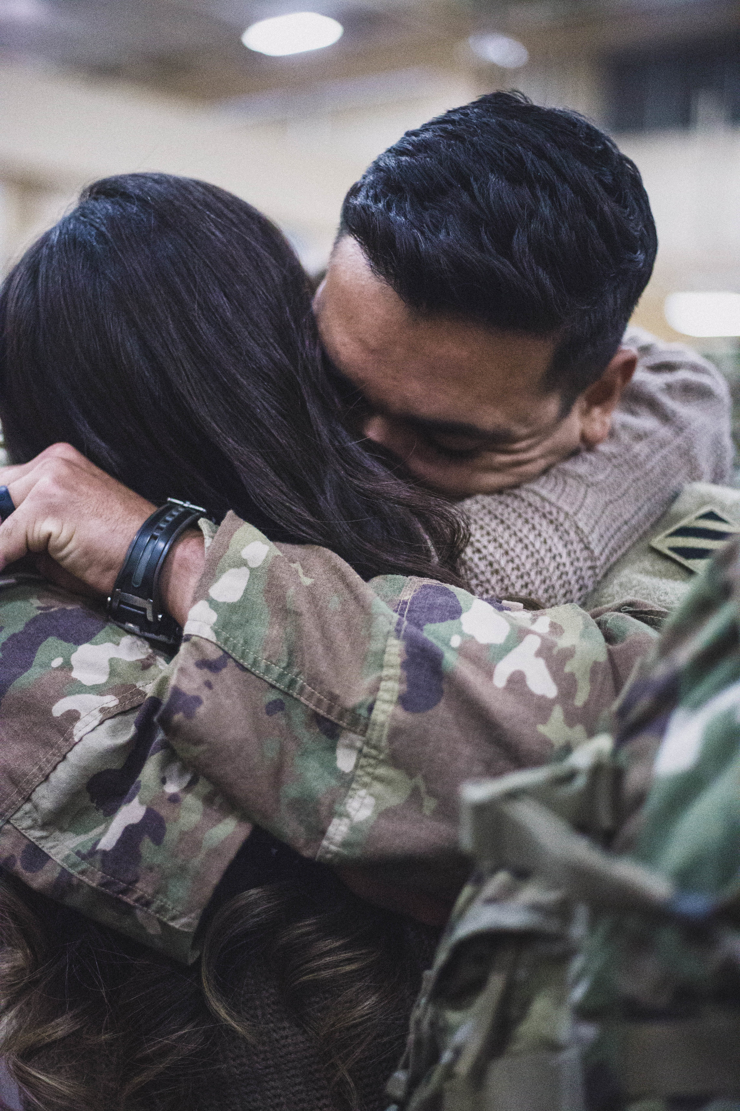 Husband and wife embrace for the first time when he returns home from nine months in Afghanistan