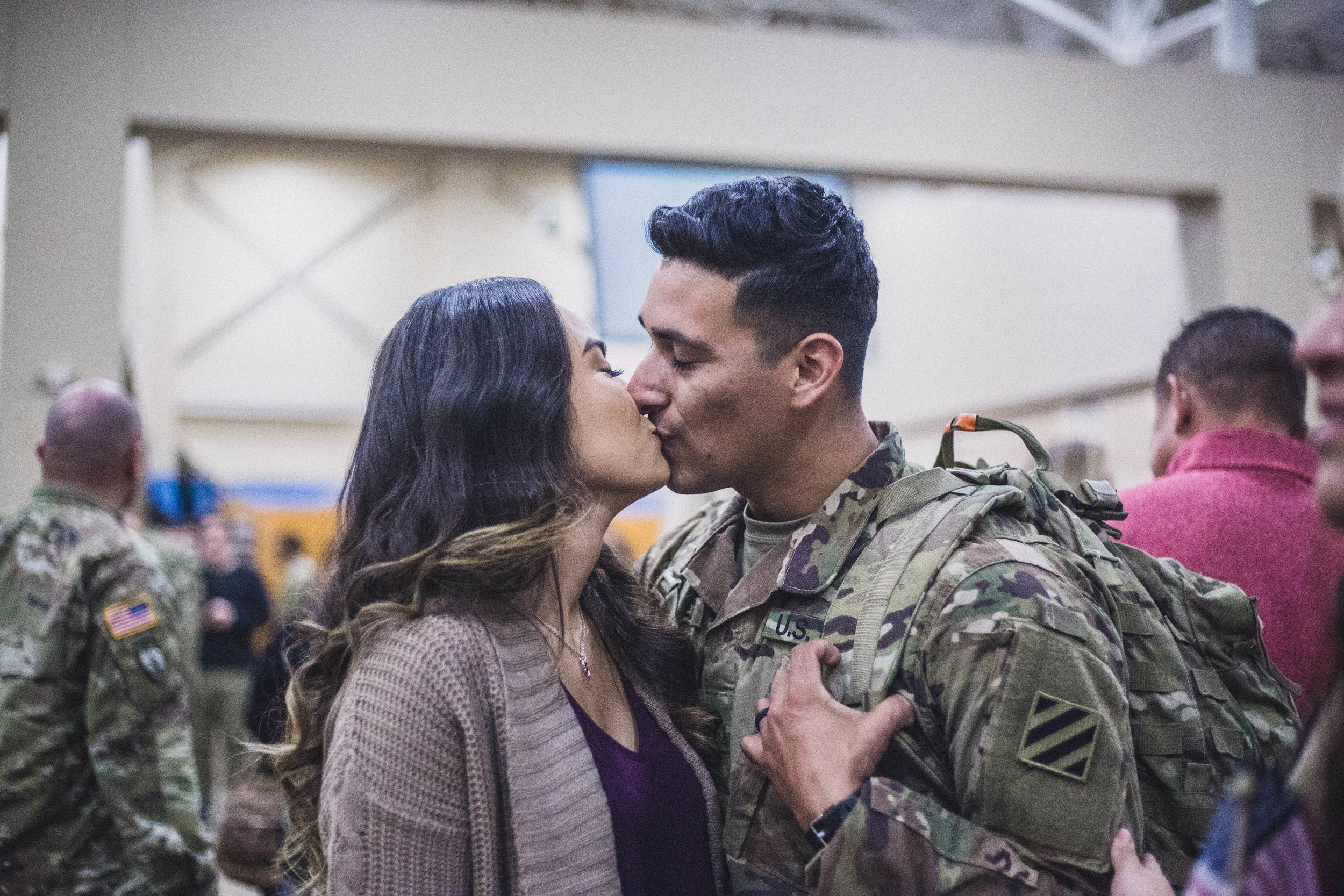 Husband and wife kiss for the first time after he returns home from nine months in Afghanistan
