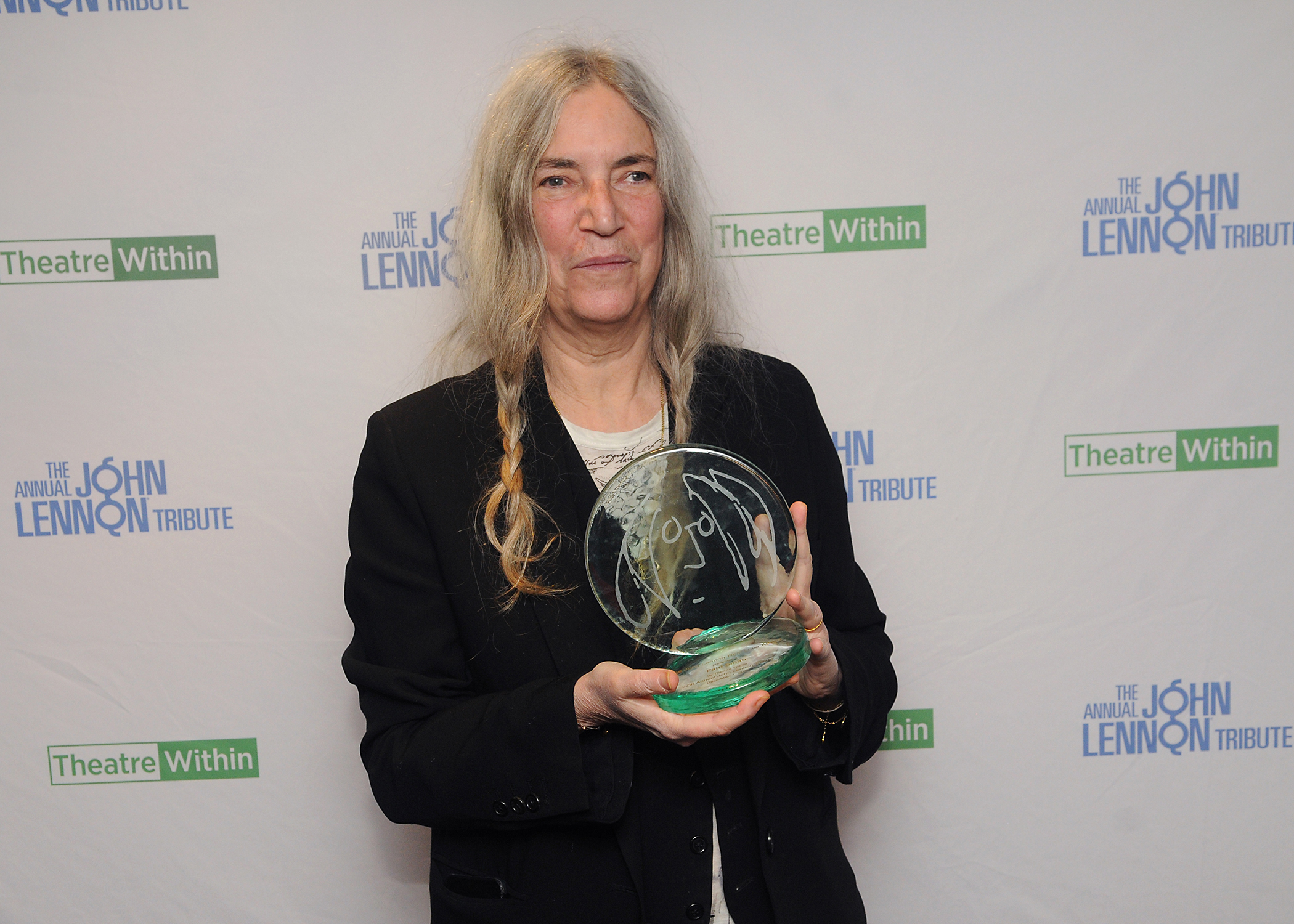 Patti WIth Award.jpg