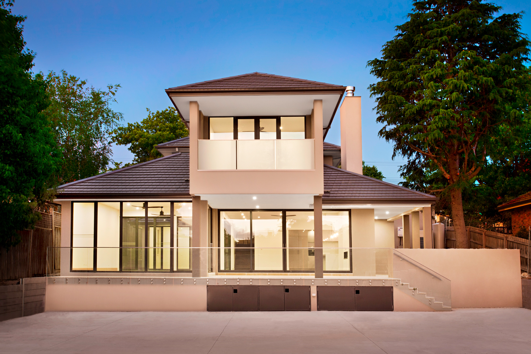 The rear aspect of this substantial, luxury home surprises, as it rises up out of a relatively discreet single story front elevation; tucked in the leafy streets of Canterbury. - Design: Ilario Cortese Architects  Contruction & PM: Matclair