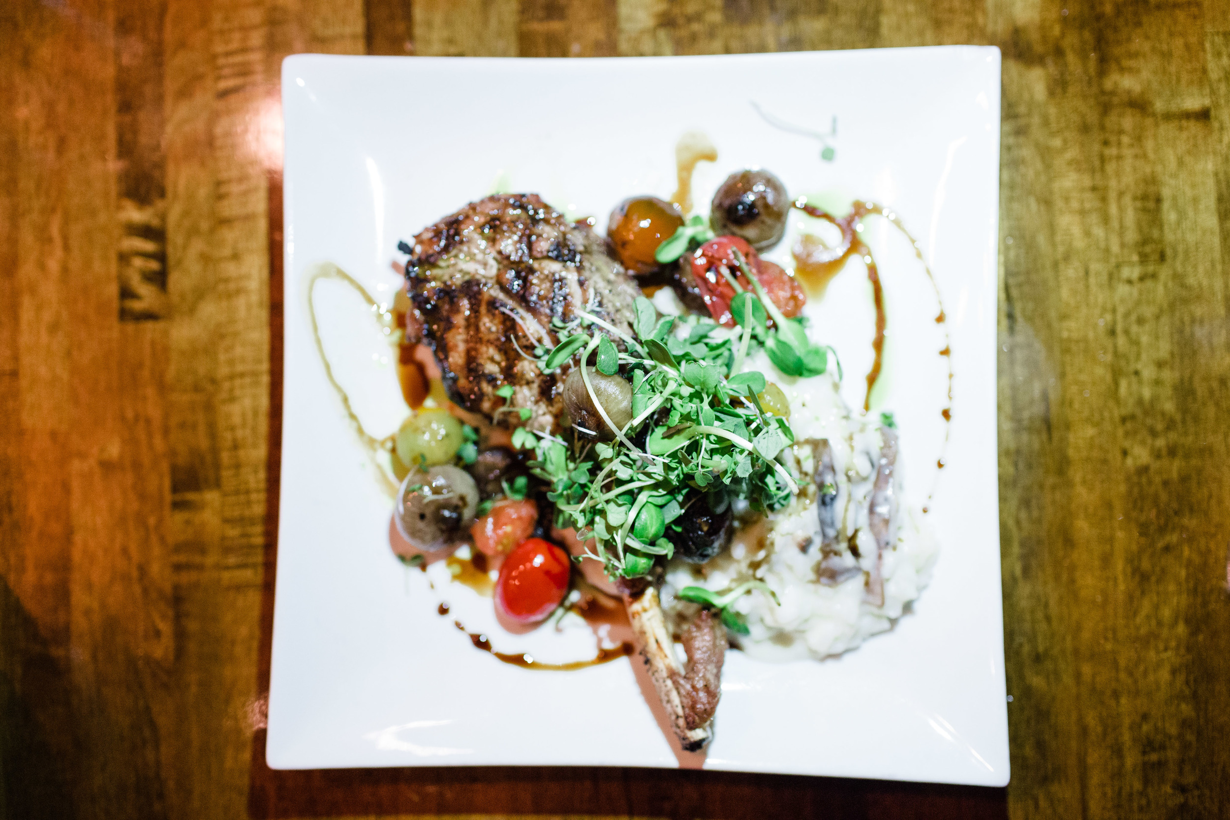 free range veal chop, creamy polenta + grilled cipollini onion + tomato