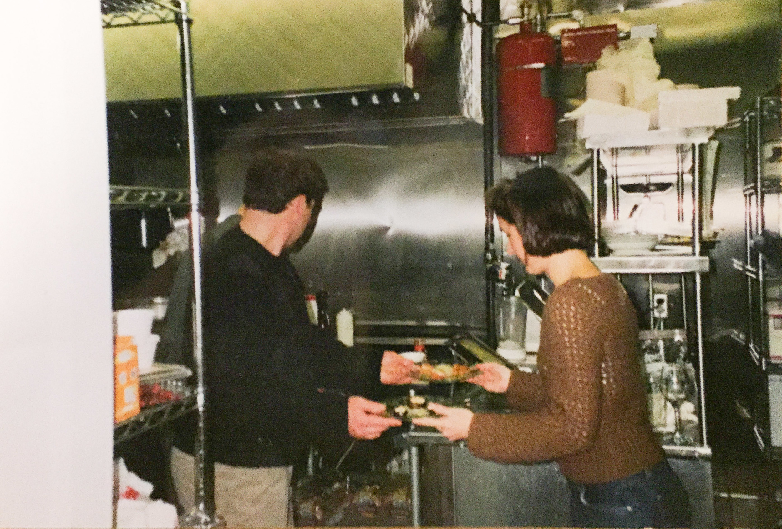 Stephen and Inez working in the kitchen on On the Square's opening night.