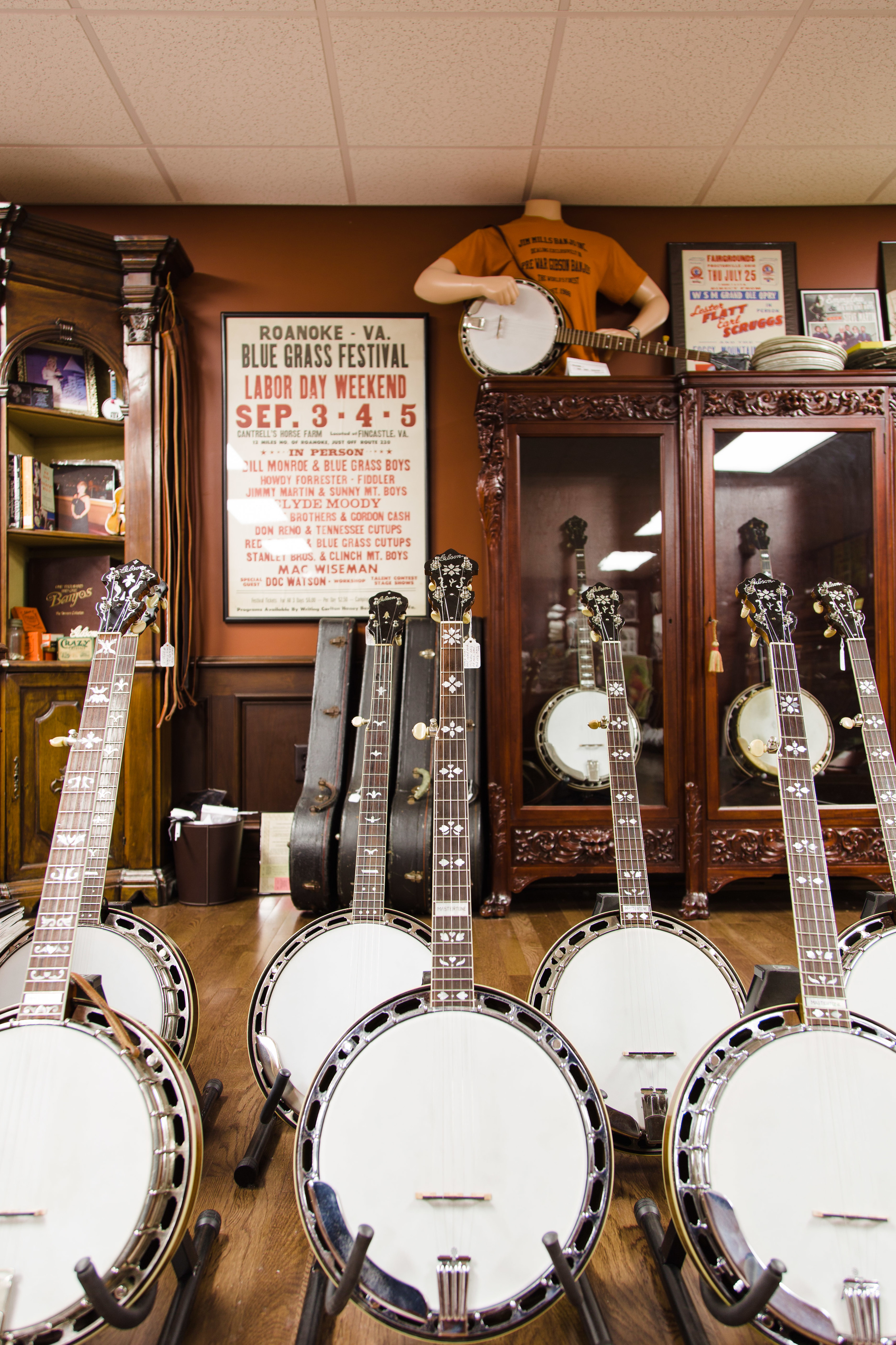 Seven of Mills' banjos waiting to find new homes.