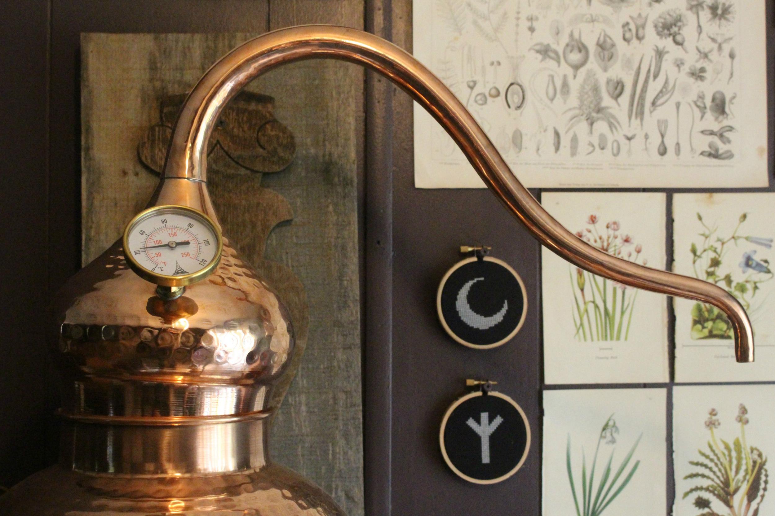 A copper distiller in Ash Sierra's home