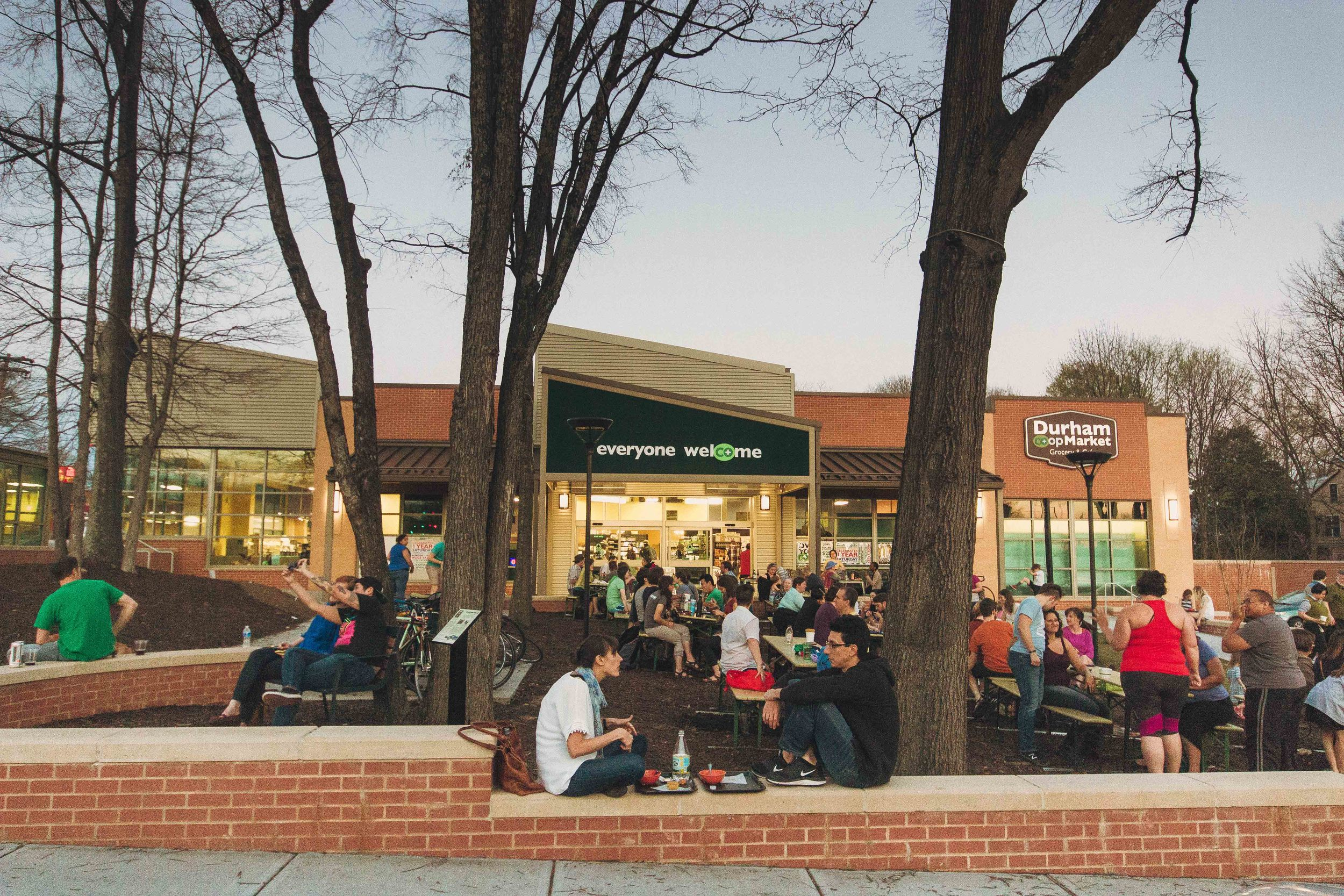 crowd gathers on a Thursday evening for the weekly $3 dollar dinners hosted by the Durham Co-op Market