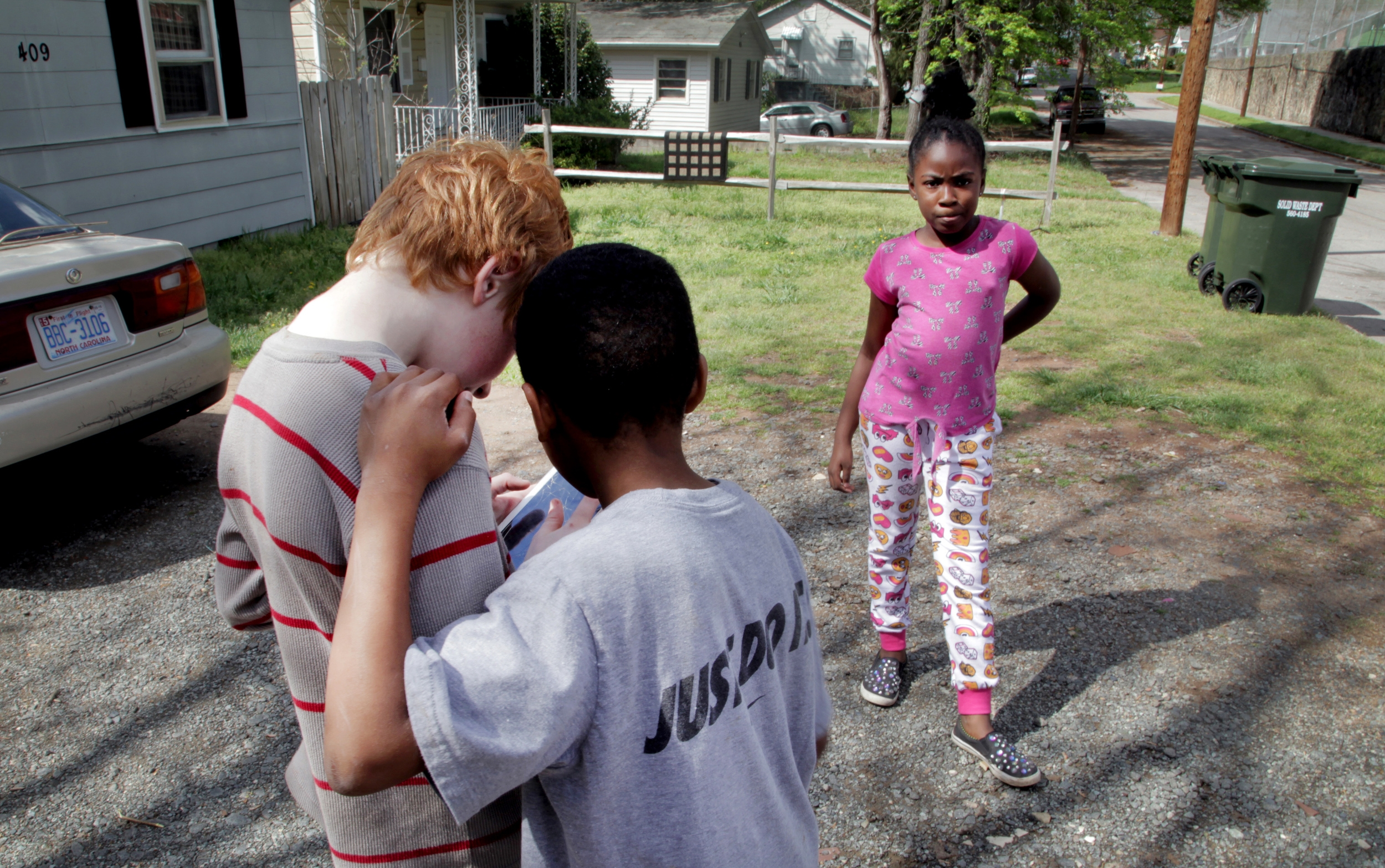 In Lyon's driveway, the boys look up the gas masks, goggles, and boots they hope to buy on the cracked screen of Barrett's tablet. She confirms that she also wants to buy some supplies for the club. Bunting points out the goggles he's got slated for Barrett. Blackjack Club will be ready.